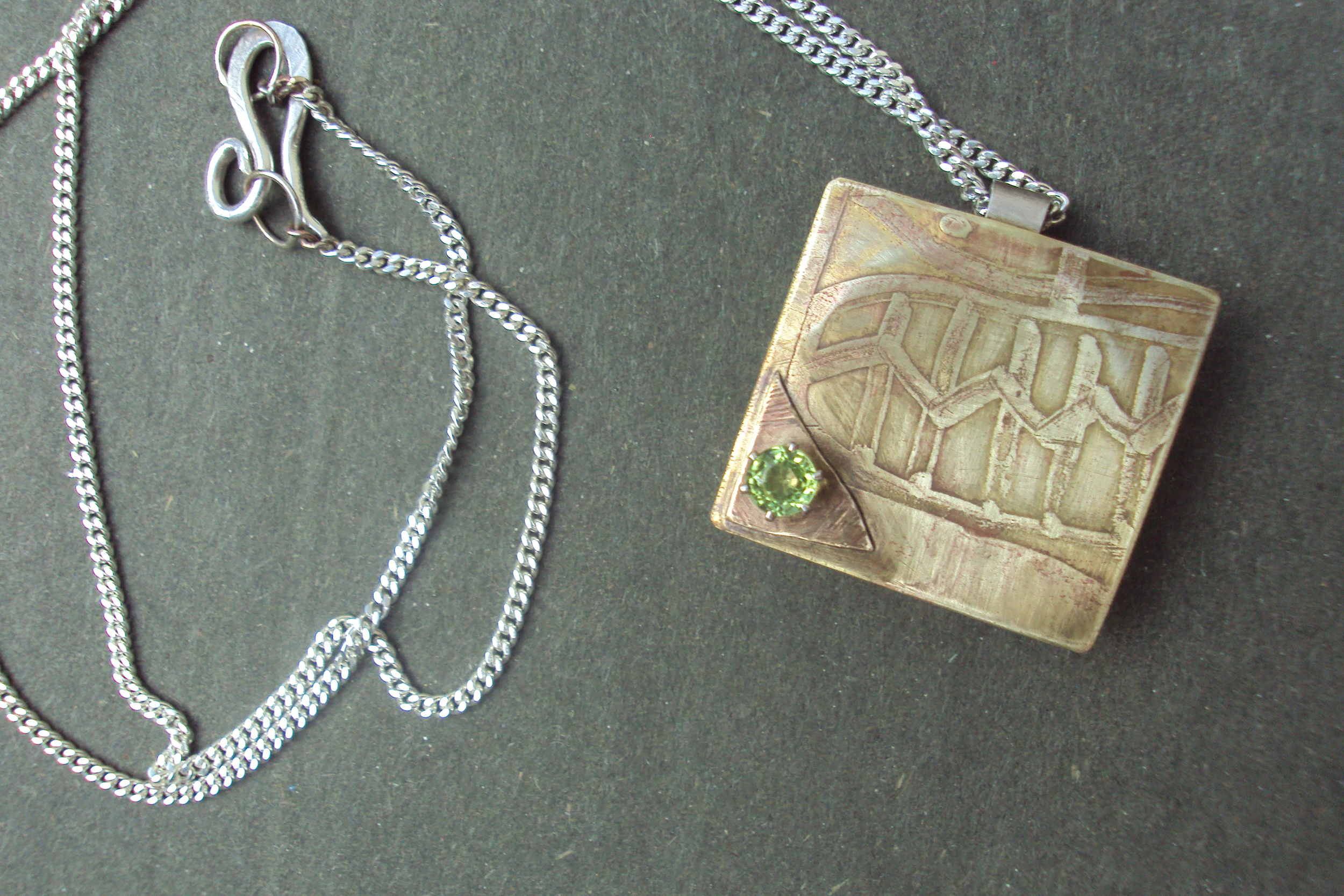 Pendant-  Etched brass box with 60pt. peridot steel chain ss clasp $196