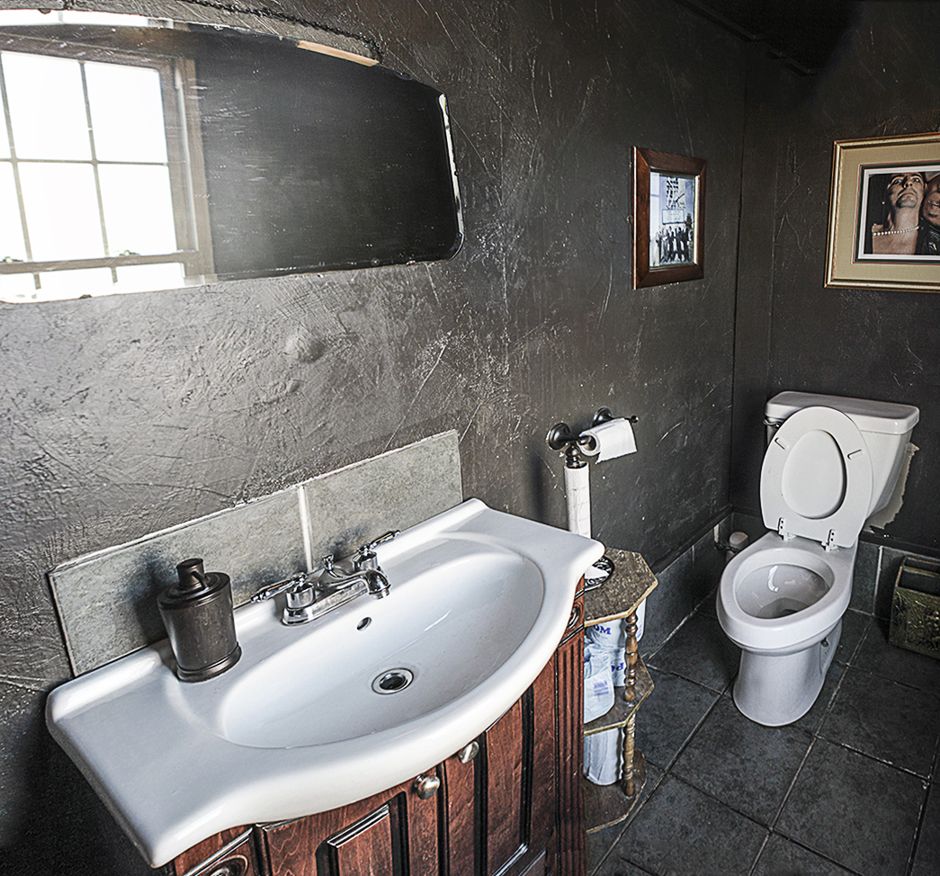 The pleasantly scented men's room of Paschall Bar.