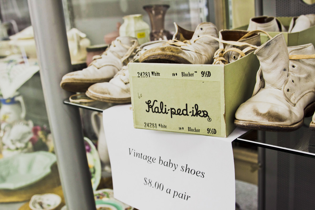 Vintage baby shoes sit on a shelf in Ruth's Room off of University.  Photo by Jessica Livesay