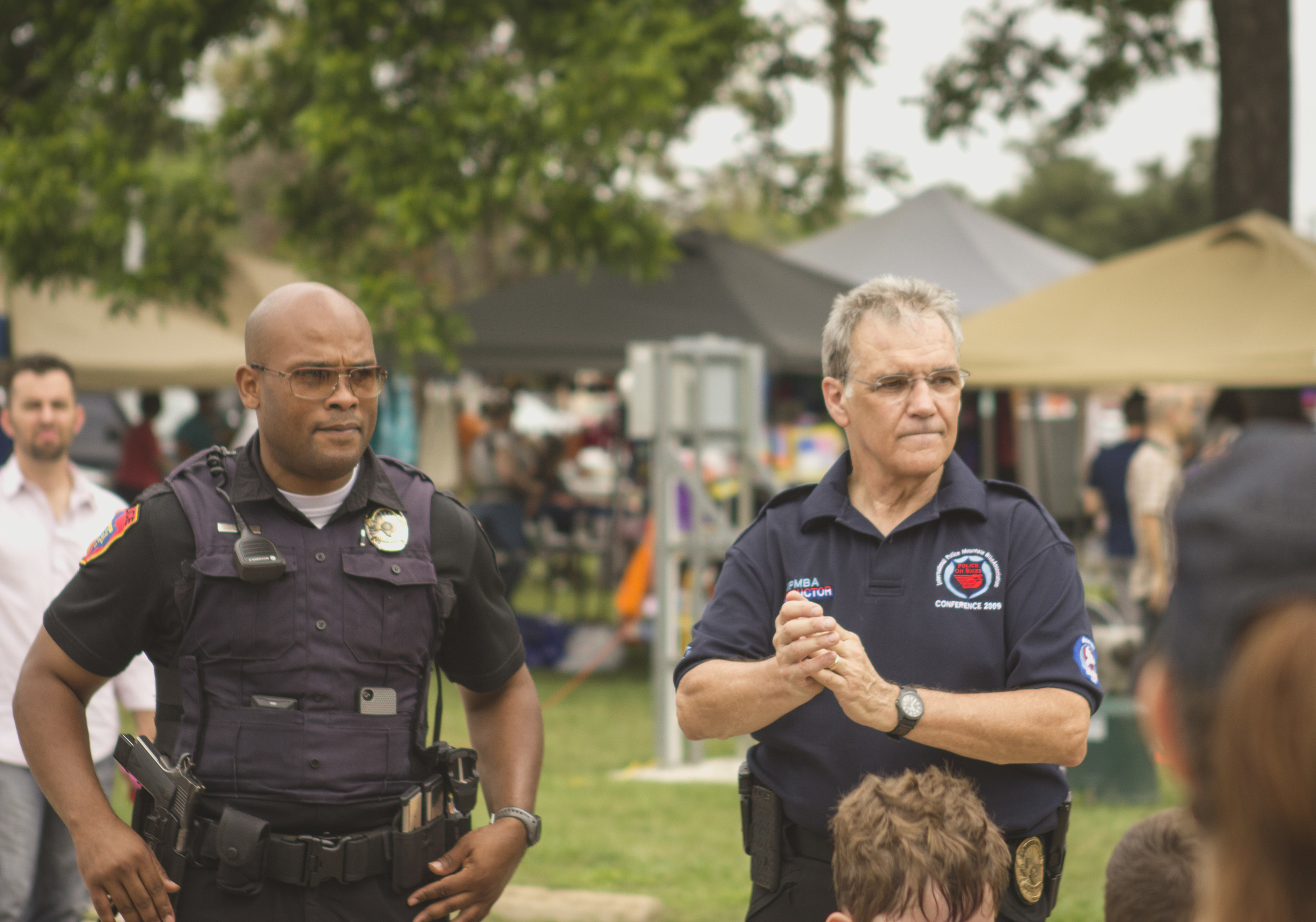 Denton Police Lt. Thomas Woods and Denton PD bike officer, Donnie Carr, look on as kids practice bike safety.