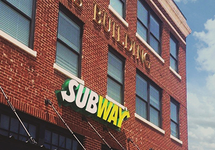 The new subway sign on the Texas Building on the Denton Town Square.