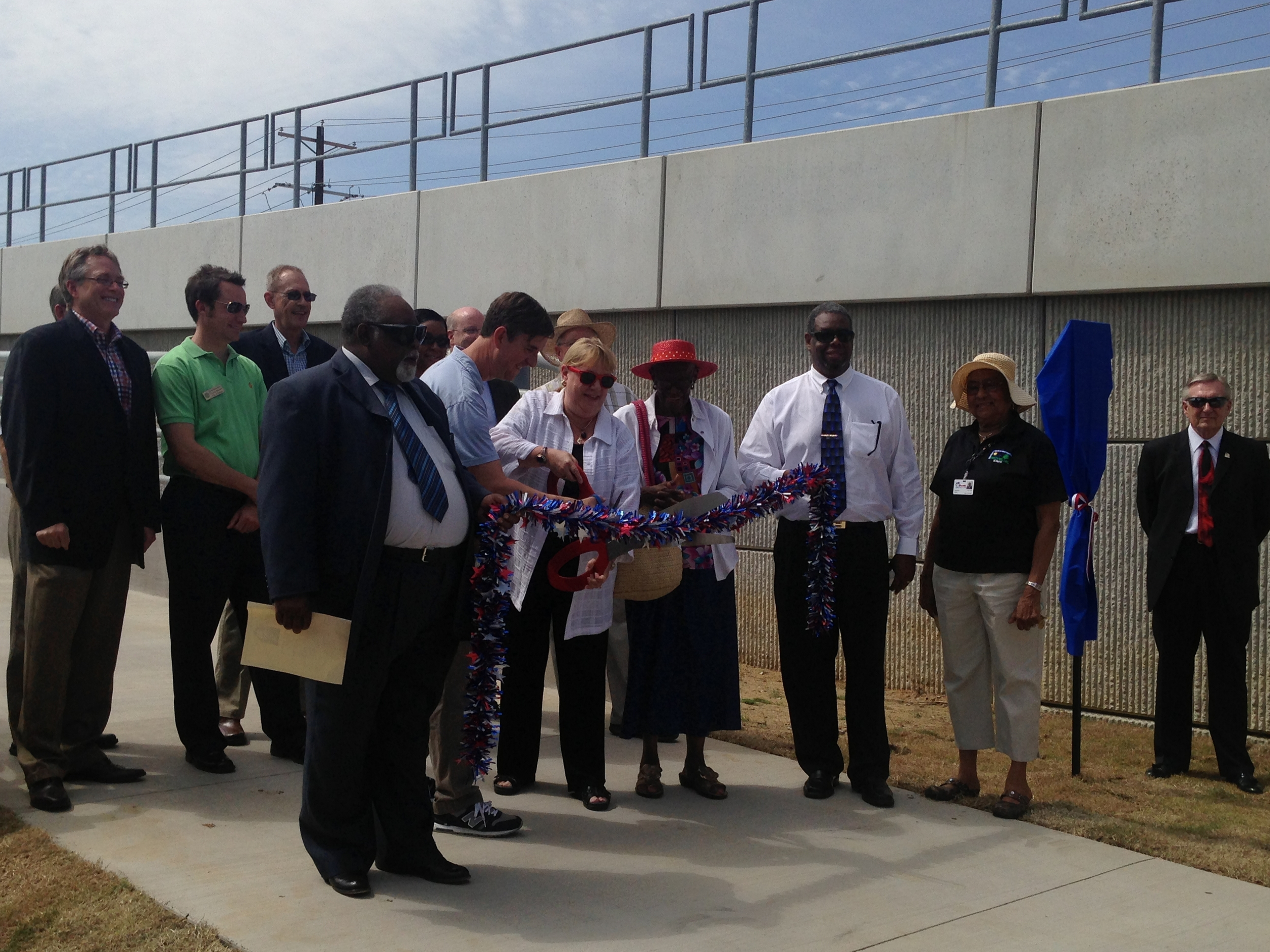 Pete Kamp and Kevin Roden cutting the ribbon for the new MLK bridge