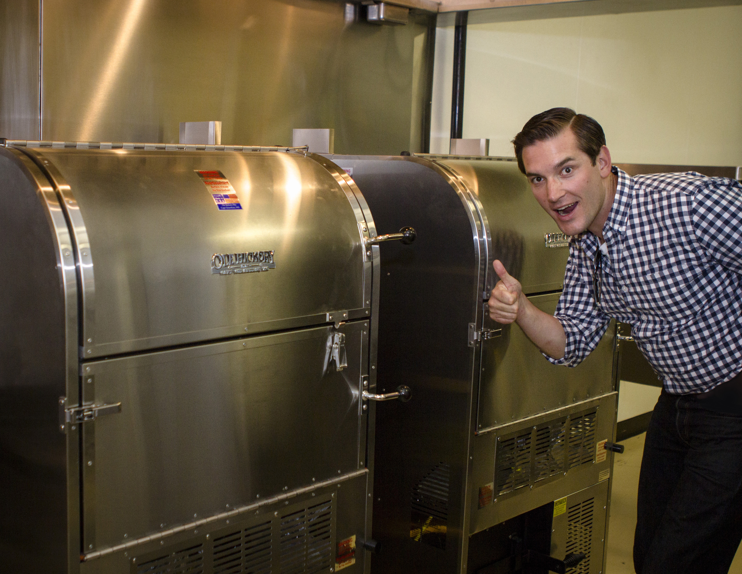 Glen Farris inspects the custom made industrial smokers inside of the forthcoming Goldmine BBQ.