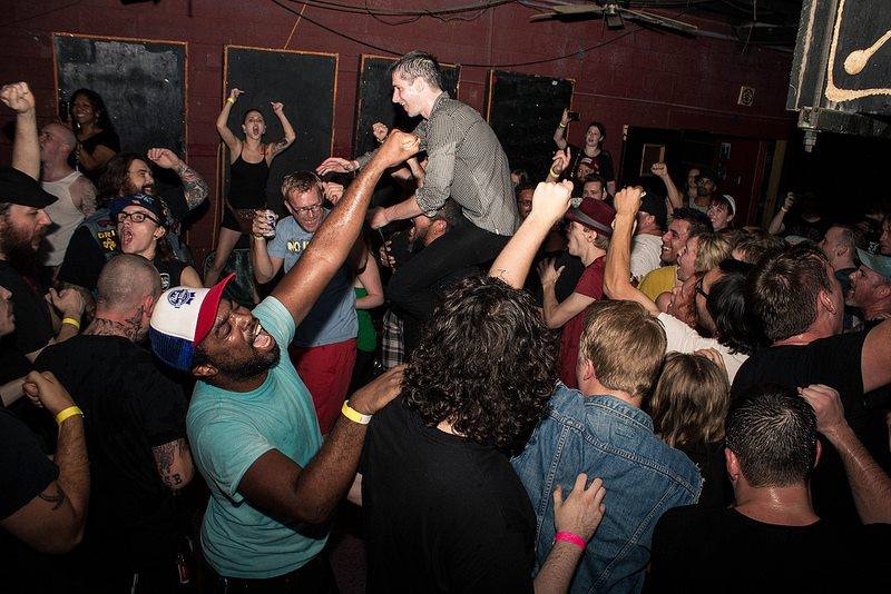 Denton native, Mike Wiebe of the Riverboat Gamblers standing in the middle of the crowd at Rubber Gloves.   photo by Dave Koen