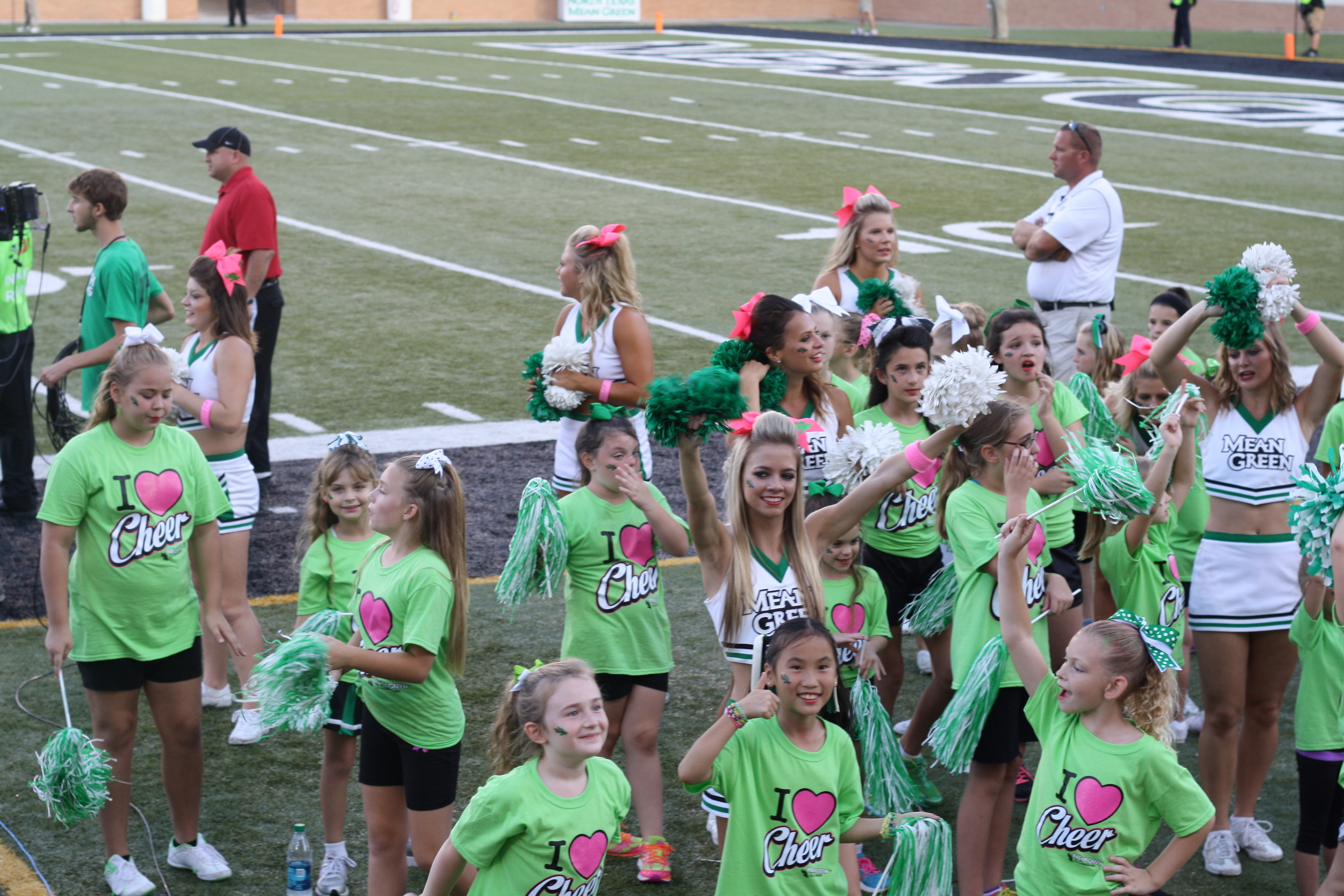 Speaking of spirit being taught to future generations - we're pretty convinced 'cheer camp' is just code for little kids bouncing around on the side lines. It's cool - its so dang cute we'll let it slide.