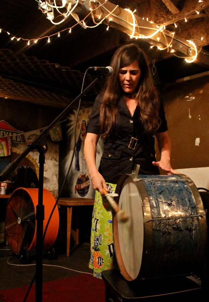 Jenny Seman of Shiny Around the Edges playing a Spiderweb Salon showcase at J and J's Pizza.