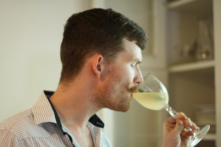 """Bartender and mustache-haver Thomas Paessler enjoying a """"pink pearl."""""""