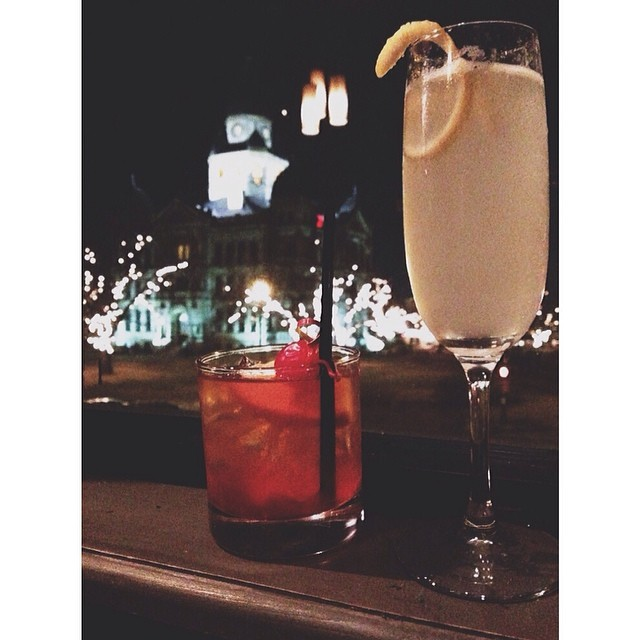 A French 77 and an Old Fashioned shared over the square at Paschall's window.Photo by Sarah Lanette .