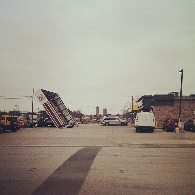 The wind knocked over 7-11. Like, literally knocked it over. This, coupled with the portion of the car wash place across the street that fell over two ice storms ago makes us think this stretch of University gets the worst of Denton weather. Photo by  @thedapperbat.
