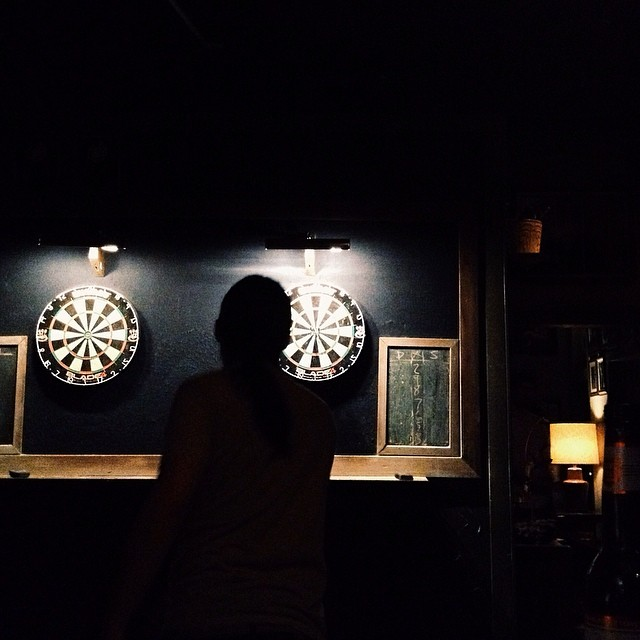 Darts at Paschall's. Photo by  Paige Gibson.