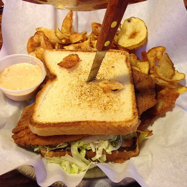 Damn good fish sandwich at Rooster's. Photo by  @hollyintexas.