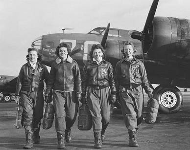 """Members of the Women Air Force Service Pilots: from left Frances Green, Margaret Kirchner, Ann Currier and Blanche Bross walk in front of a B-17 plane called a """"Pistol Packin' Mama"""" after training at Lockbourne AAB in Columbus, Ohio.  Photo courtesy of the TWU archives and the  Denton Record Chronicle ."""