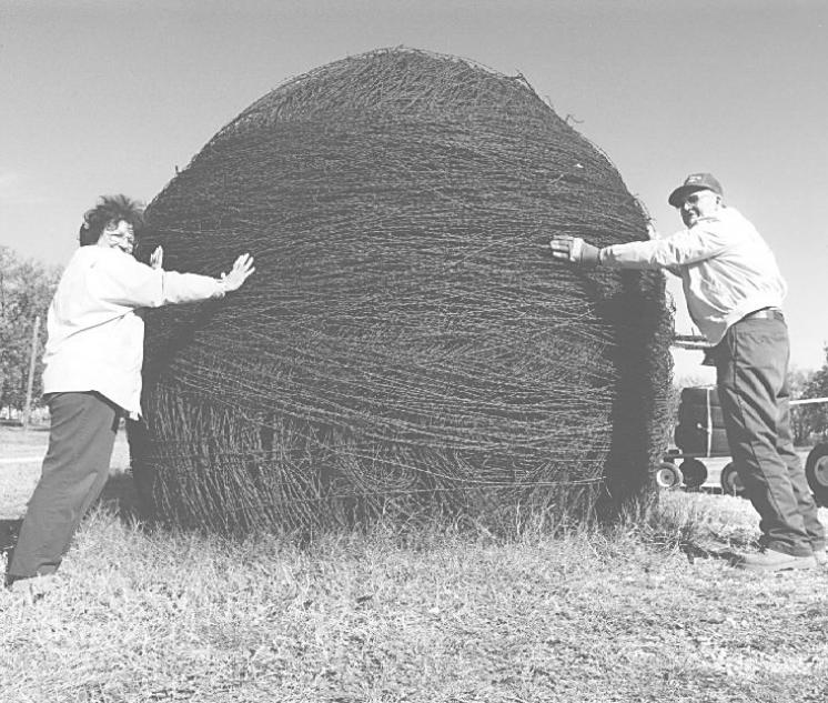 J.C. Payne of Denton TX and the world's biggest ball of barbed wire.