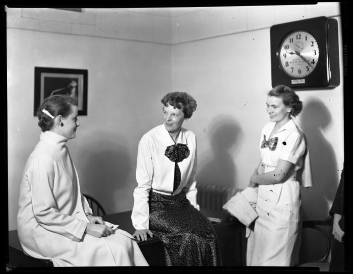 Amelia Earhart chats with two unidentified TWU Pioneers during her 1936 visit to Denton TX. Photo courtesy of the  Portal to Texas History .