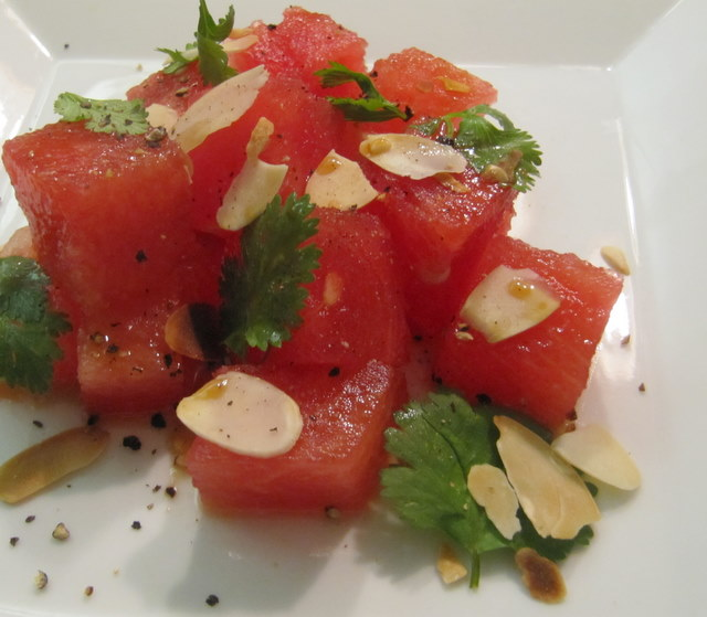 Savory Watermelon Salad.  This is SO good and summer's the time to do it.  I added cubed or crumbled feta on top.  DELISH.