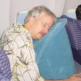 i am SO MAD at myself for not thinking of this portable pillow myself. it's so much better than the neck pillow. the only drawback is the slight embarrassment of blowing it up and then feeling awkward about deflating your breath into recycled airplane air after you land.
