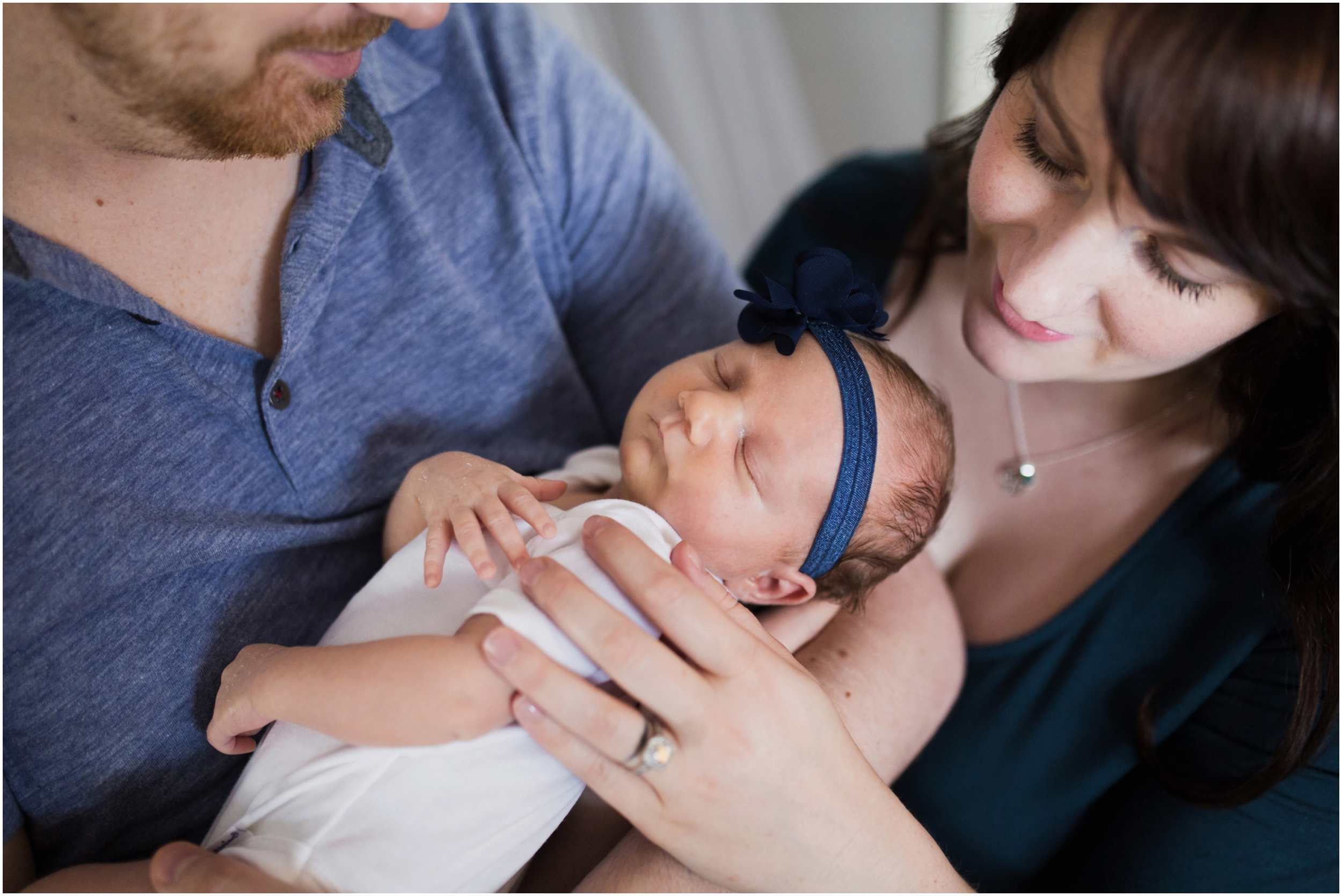 mom-and-dad-holding-newborn-photography.jpg