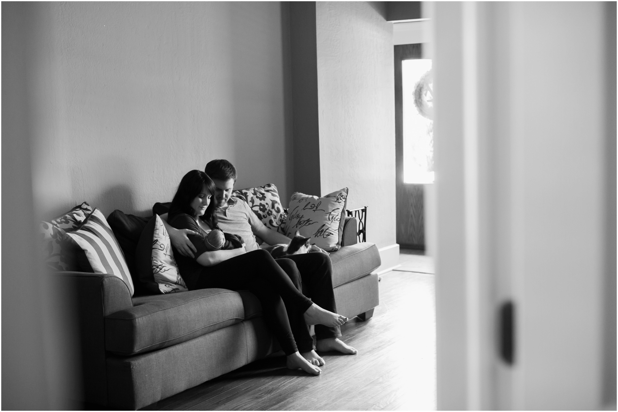 Newborn-Photo-Family-on-Couch-Black-and-White.jpg