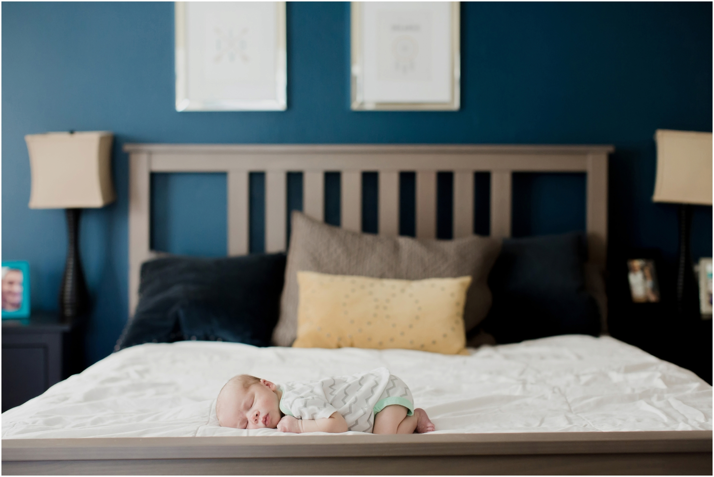newborn-baby-on-parents-bed