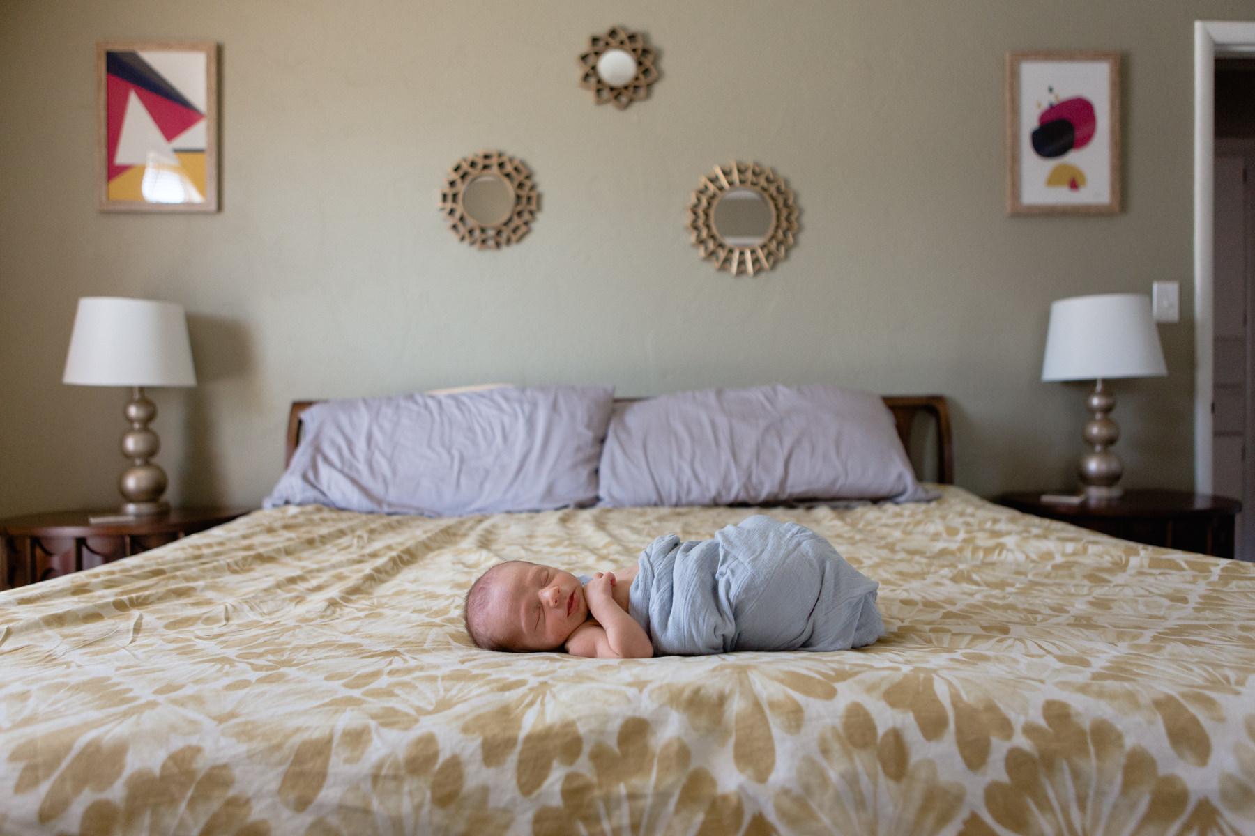 Newborn_Sleepy_Bed_OklahomaCity_Swaddled_In_Home.JPG