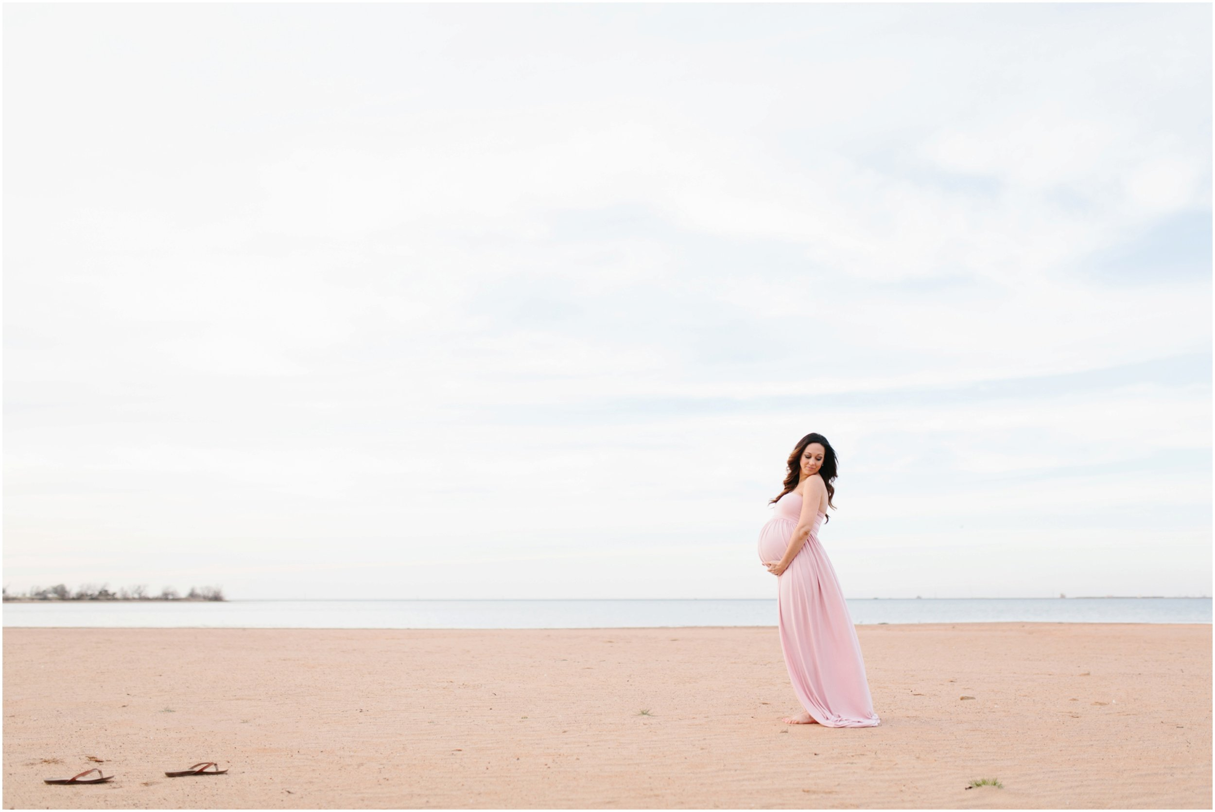 expecting mother portraits on beach at lake in midwest