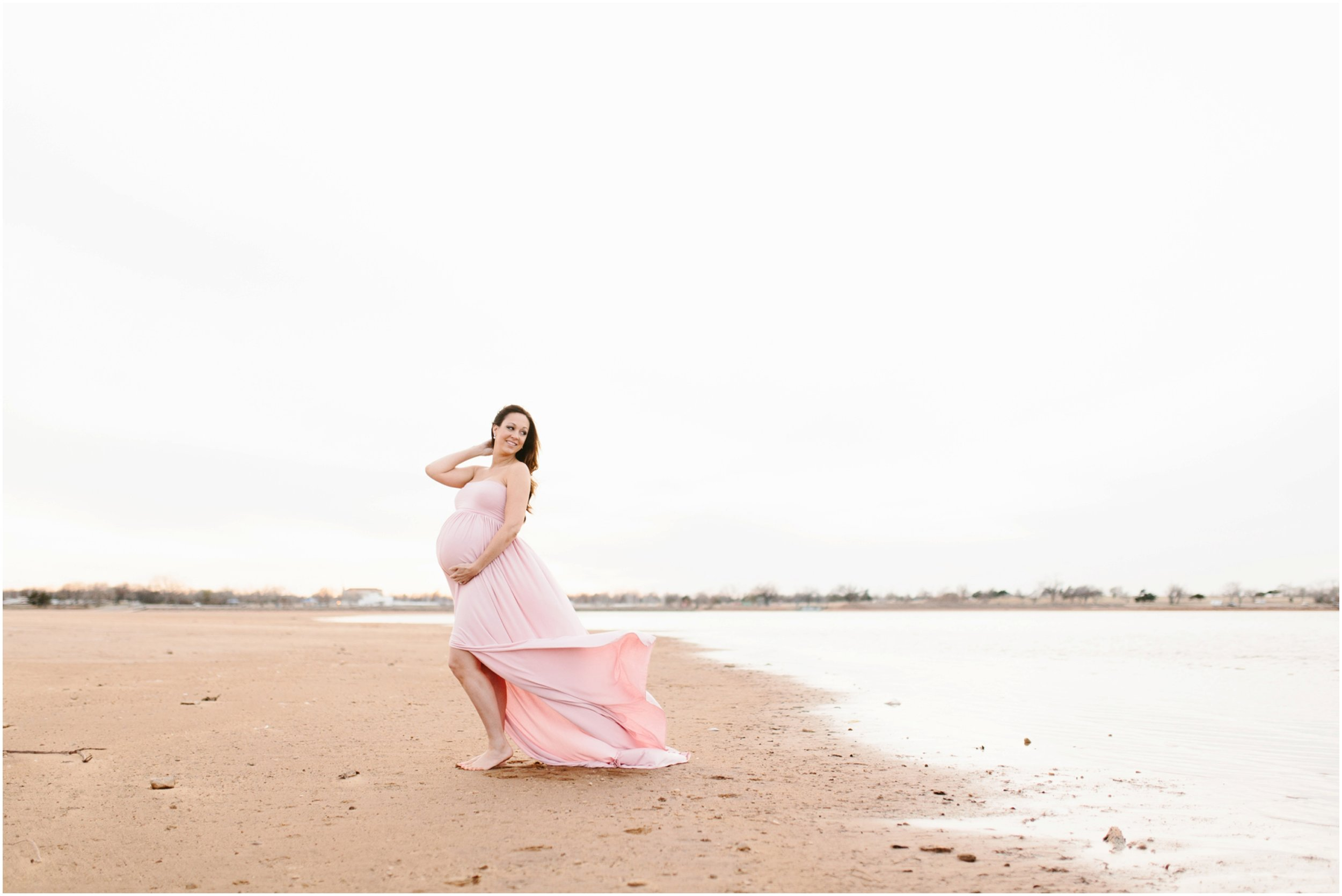 new mother-to-be maternity photos at lake in long dress