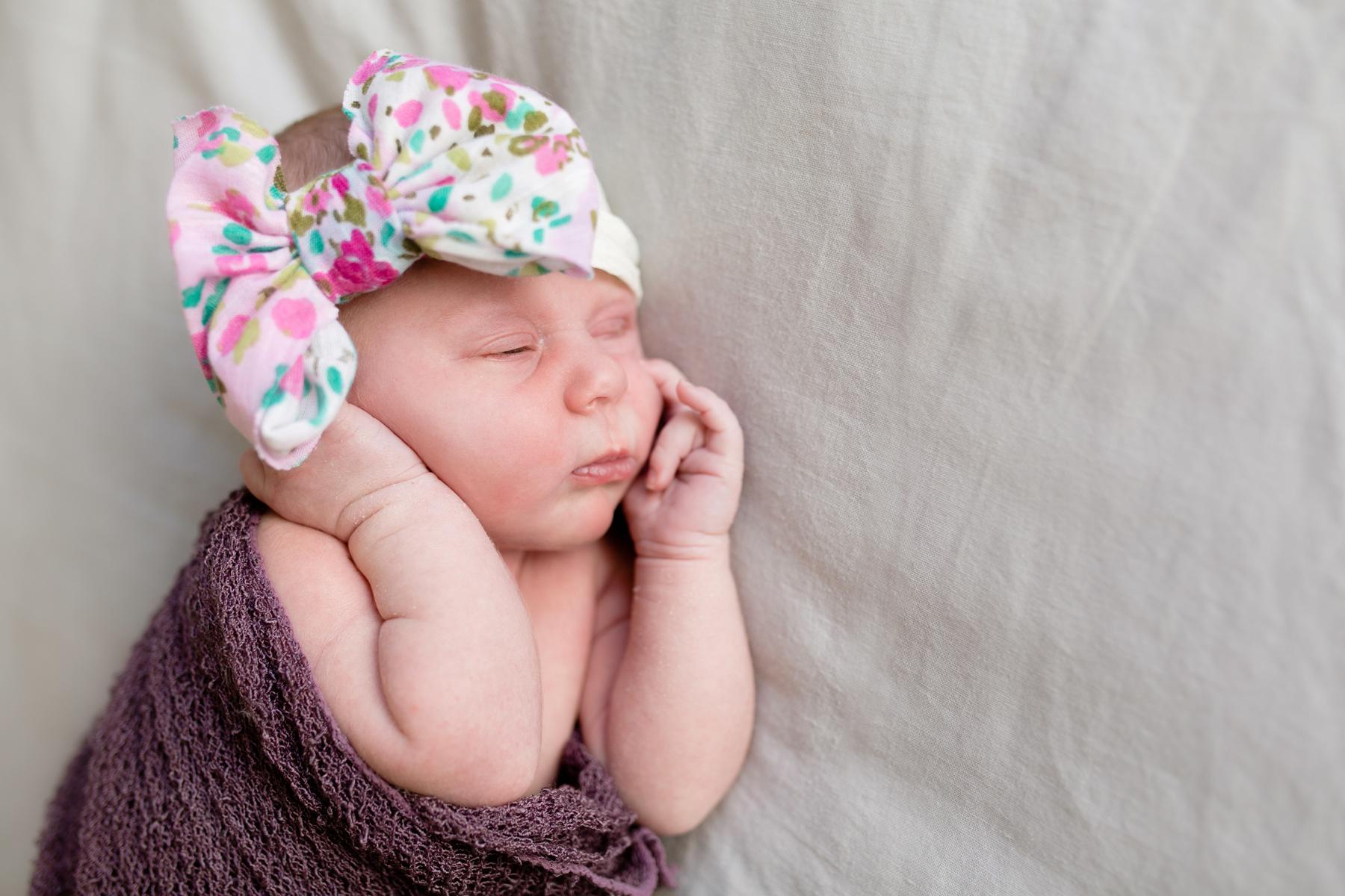 newborn_baby_girl_floral_bows_lifestyle_photographer_oklahoma.jpg