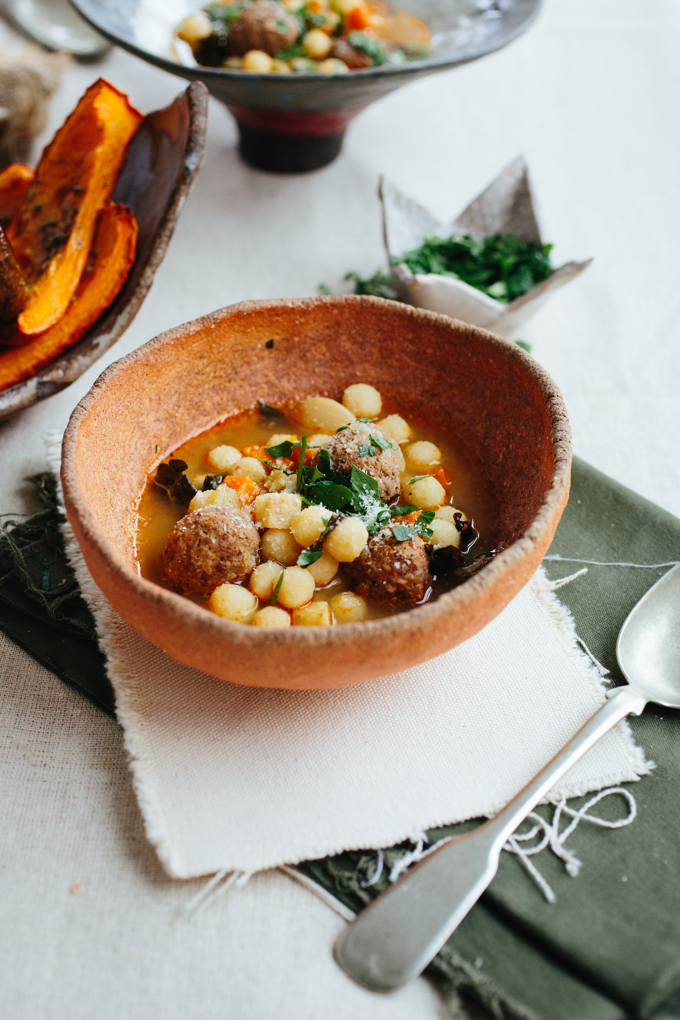 """Couscous No.6 'Mamie"""" in a vegetable soup with lamb meatballs.  Photography: Christine Han, Ceramics: Shino Takeda"""