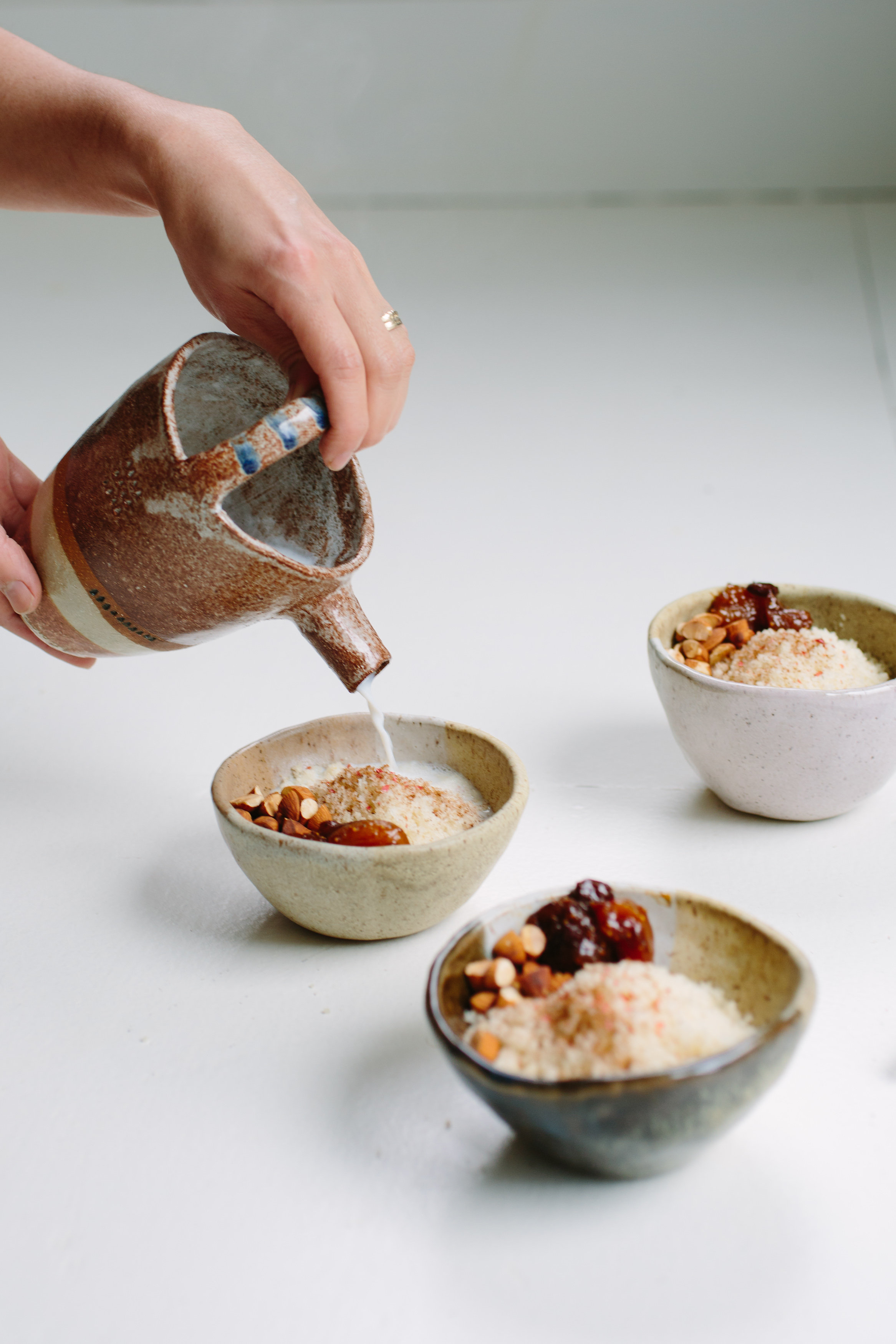 Couscous No. 1 Jajo served as a sweet morning dish with dried fruit preserve, roasted almonds, cinnamon and hot spices milk. Photography: Christine Han, Ceramics: Shino Takeda
