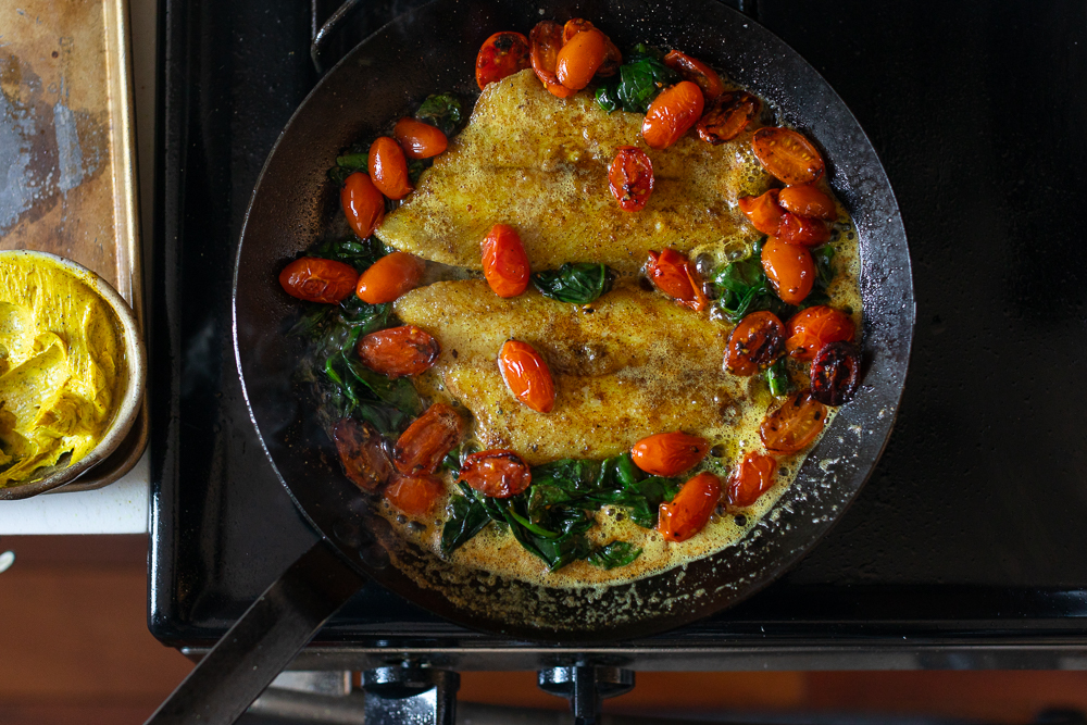 Sole Fish Fillet in Hawaij Butter with Spinach and Tomatoes