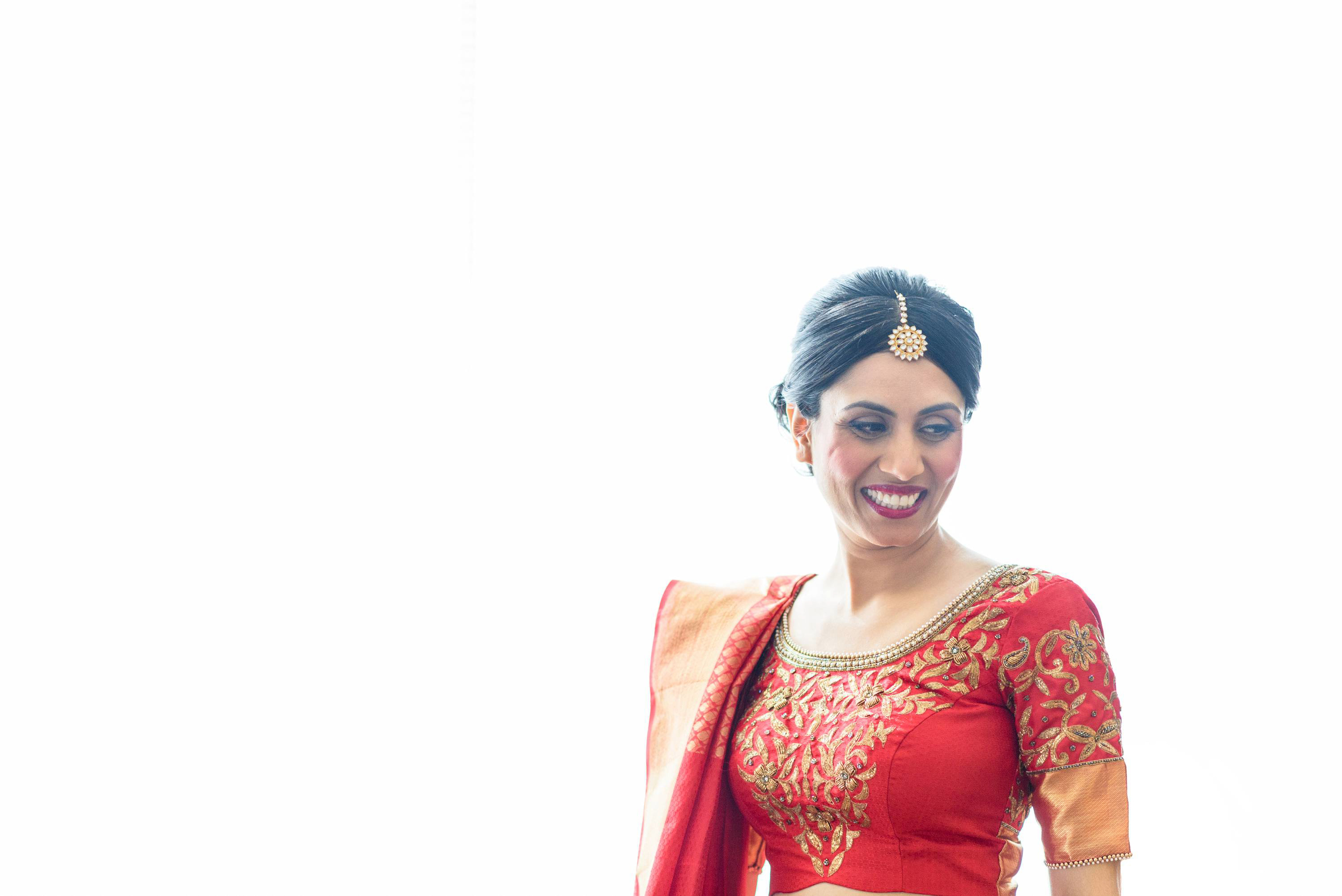 our bride chose a beautiful kanchipuram silk saree as her bridal dress for her traditional indian wedding along with hand stitched blouse