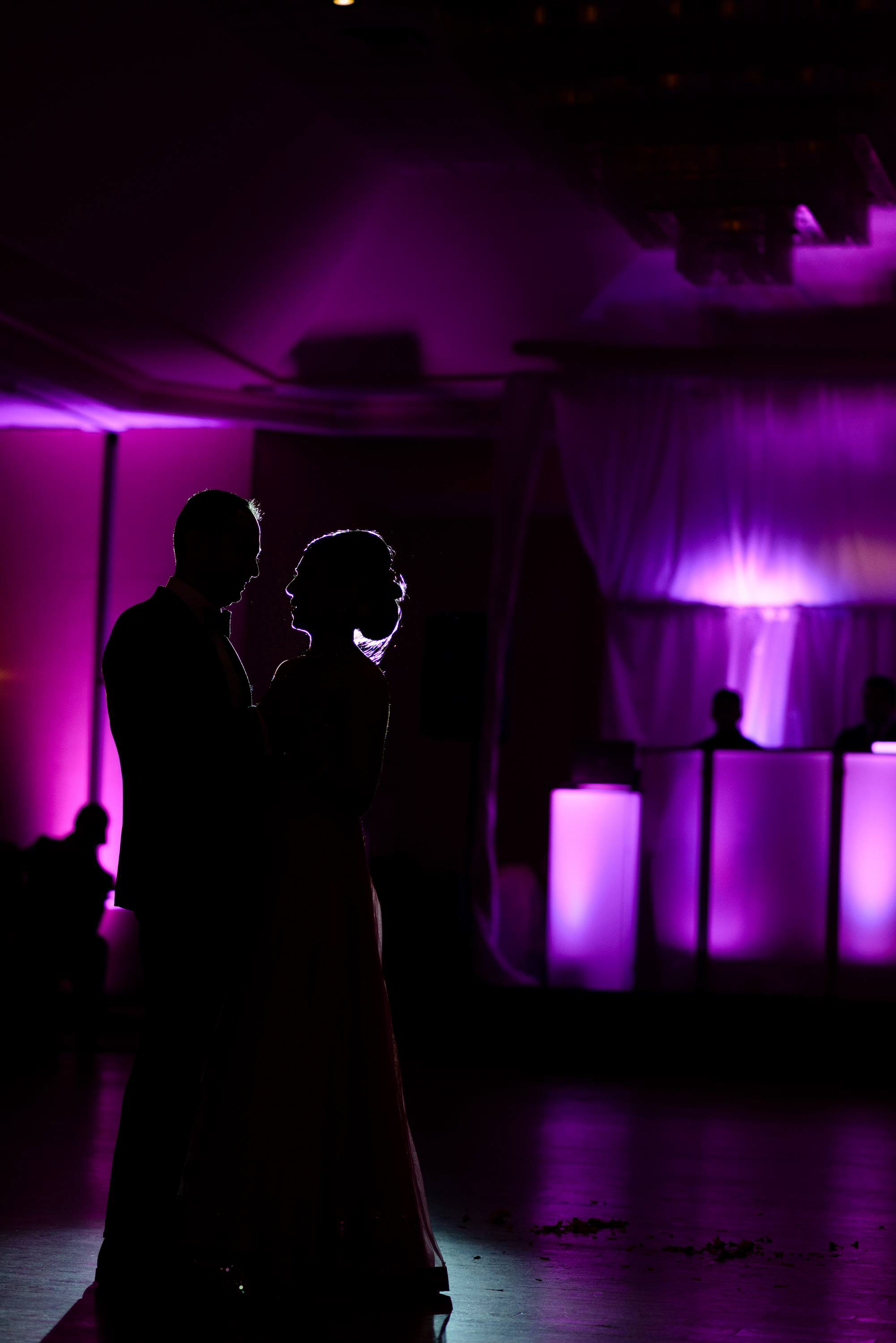 We love incorporating the wedding colors and decor while taking wedding photos. The bride chose purple to be her primary color for the wedding reception
