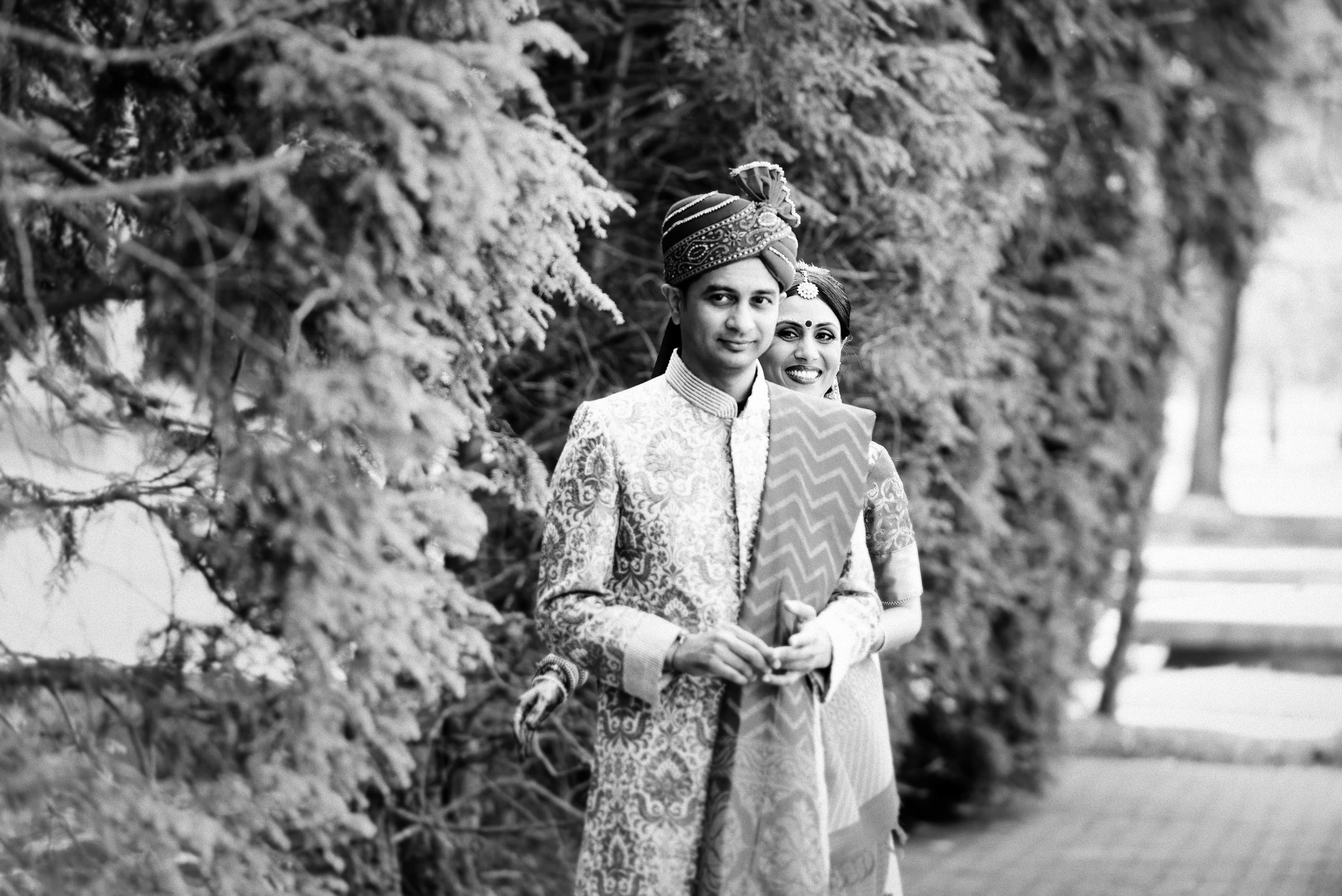 This picture is a amalgamation of curiosity, happiness, excitement & a beautiful moment. Groom was waiting for bride for first look with mixed feelings but composing himself for a delightful moment.