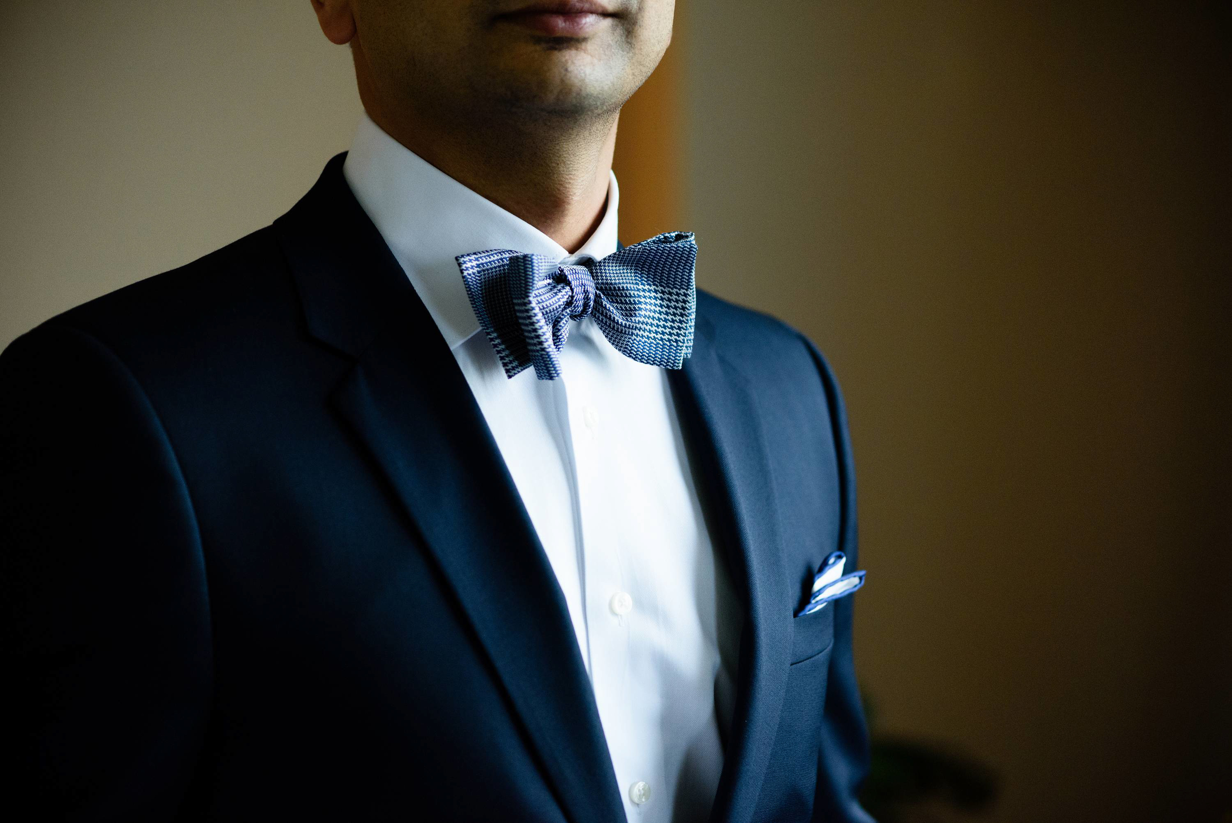 It's in the details! This stunning and sharp bow tie of the groom caught our attention and took this photograph when he was getting ready for the reception.
