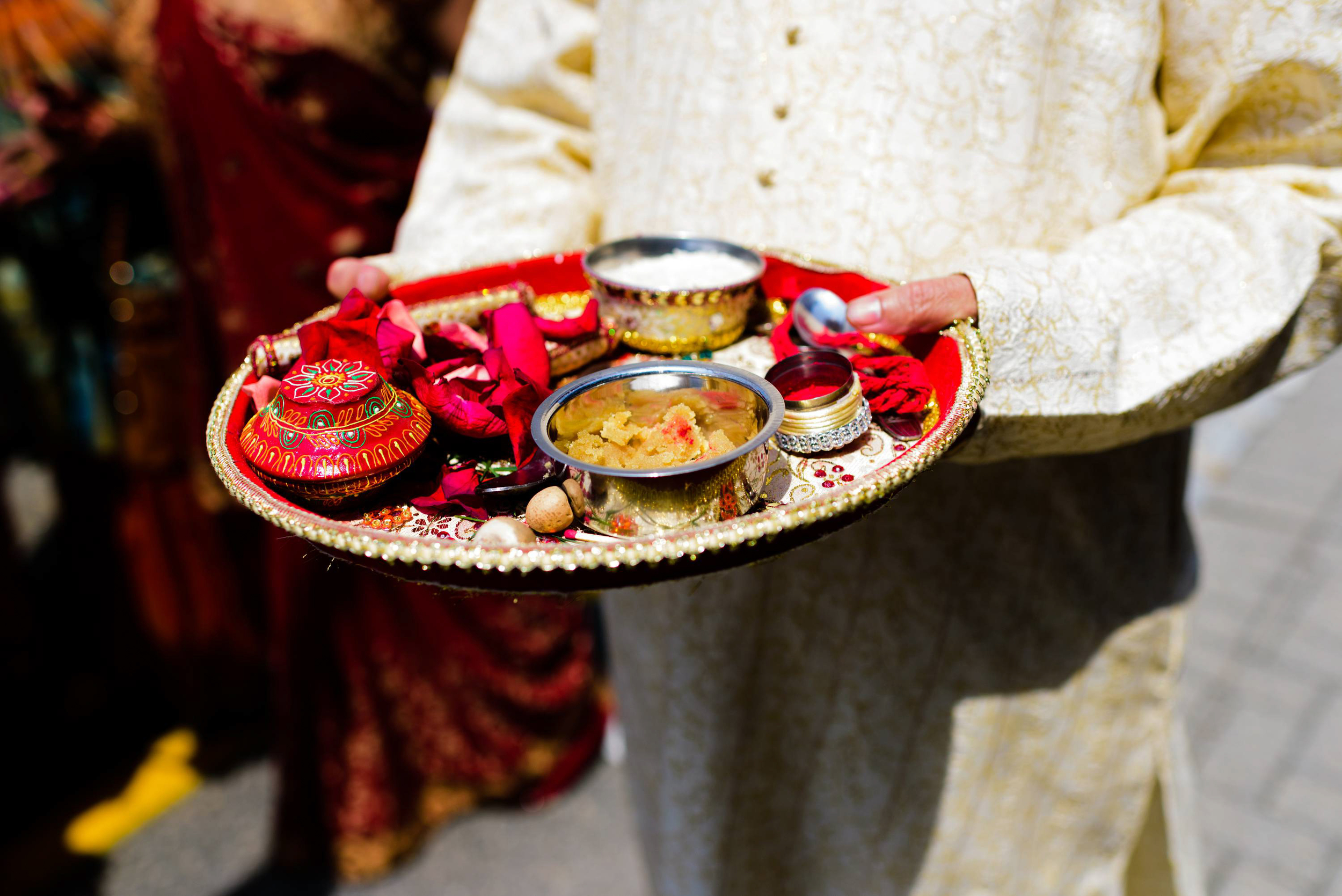 The bride's mother initiates the tilak ceremony using the contents of the shagun ki thali or Pooja thali. As soon as the baraat arrived the groom and the groom's family are welcomed warmly.