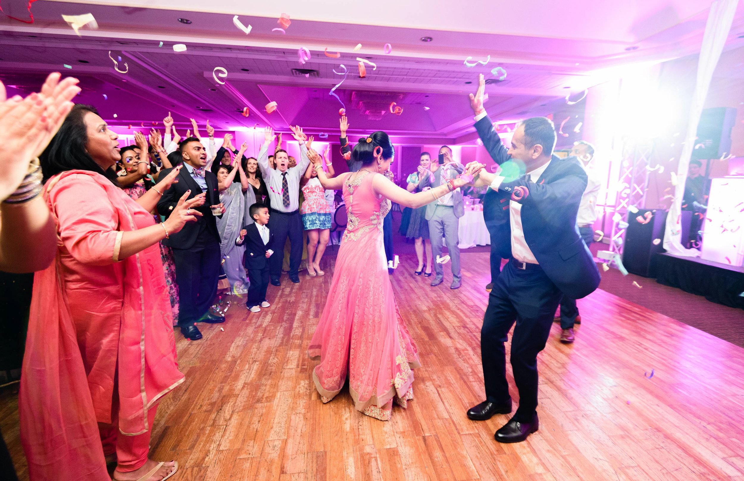 the guests poured in on the dance floor after the bride and groom's first dance at their reception