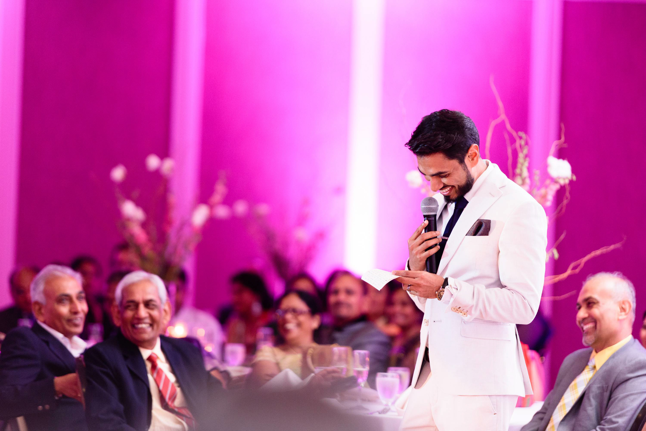 Bride's brother delivering a toasting speech for his sister & brother-in-law. We love that you can see the guests reaction in the background