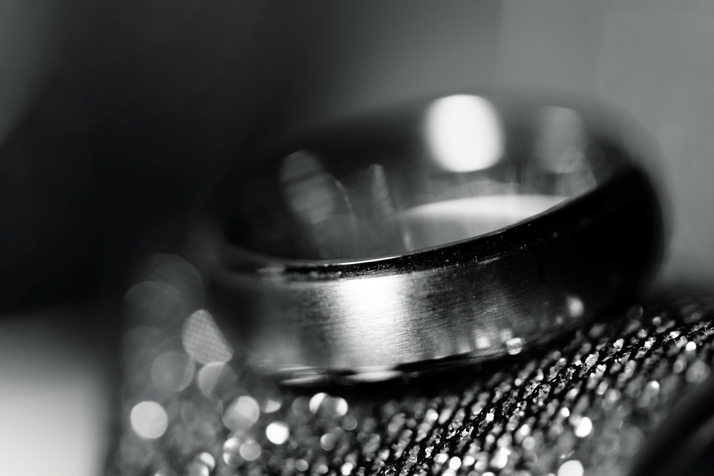 Wedding band on the bride's wedding shoes.