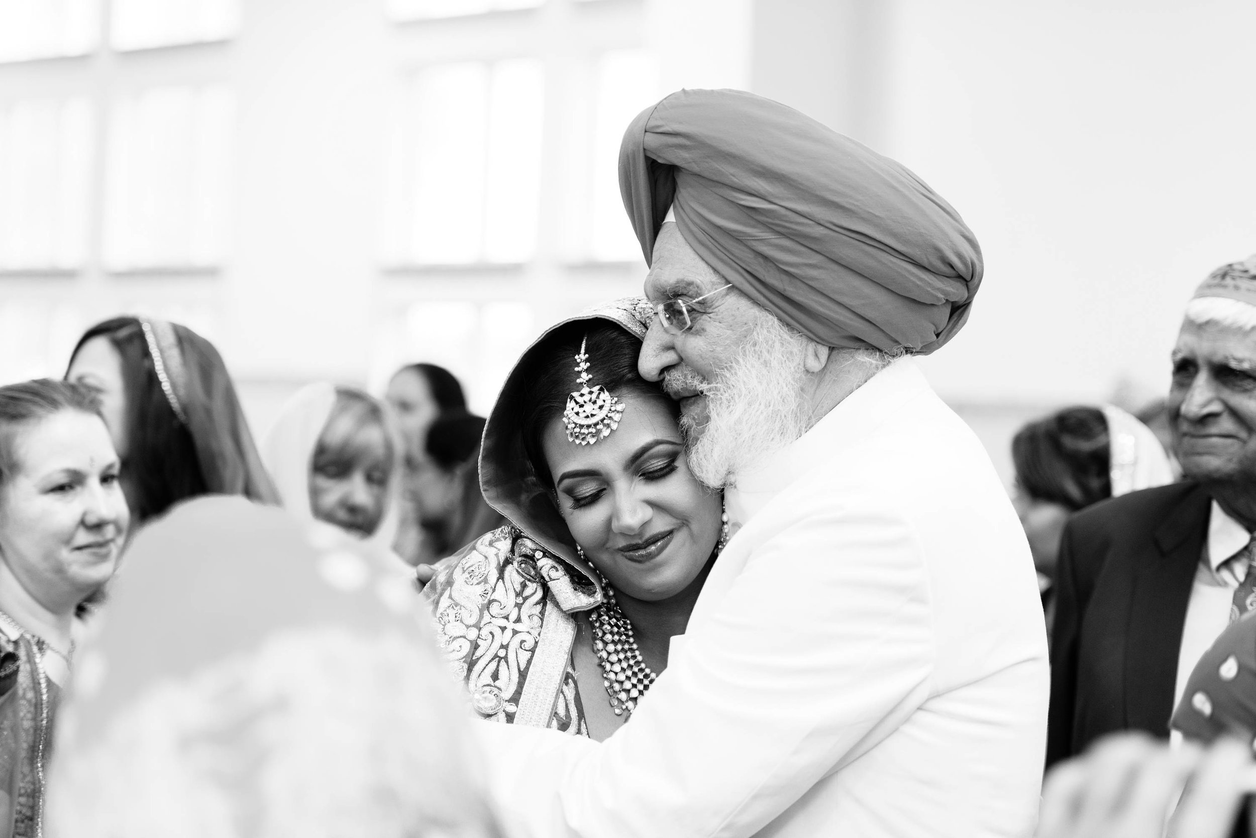 A beautiful moment captured of the bride and the grandfather right after the ceremony. The bride is very close to her grandparents.