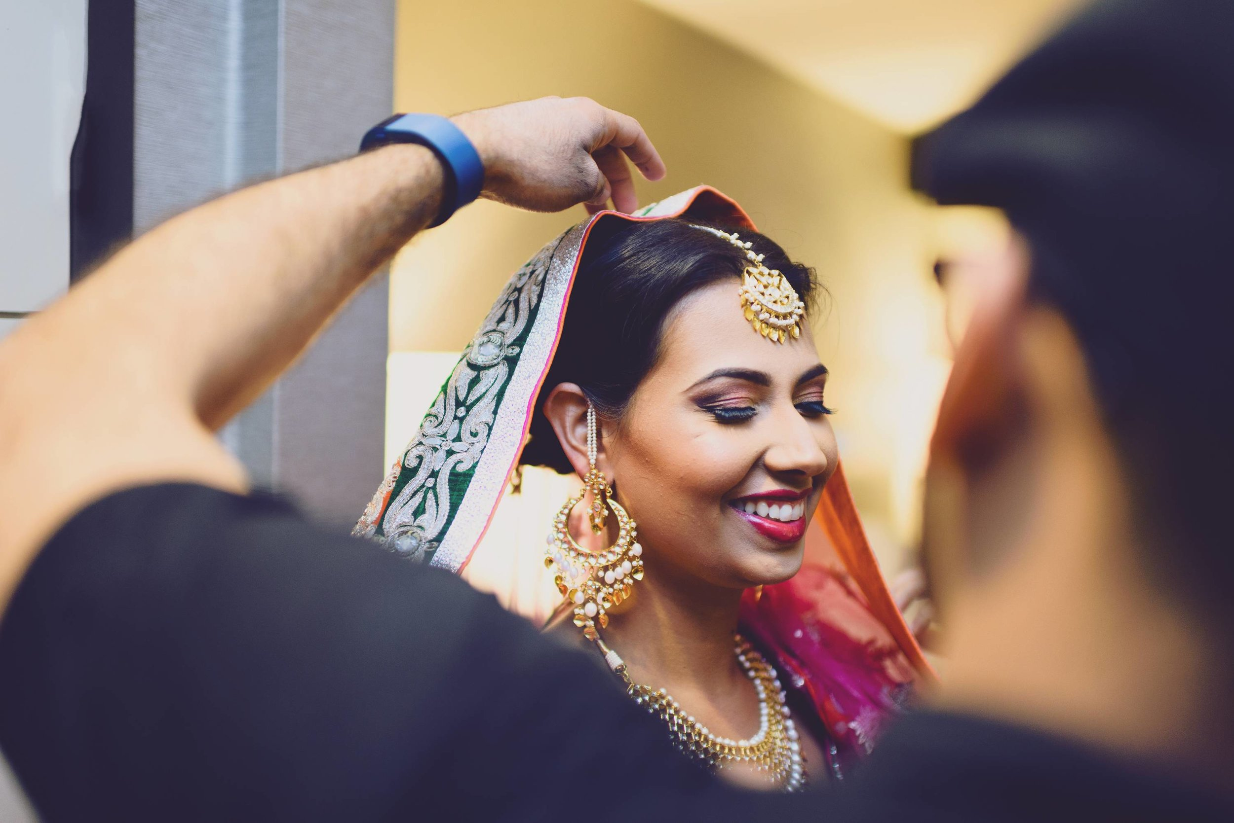 Sim looked alluring in her hot pink & orange lehenga. She wore this dress for her south asian sikh wedding. Indian weddings are known for vibrant colors and extravagant bridal gowns.