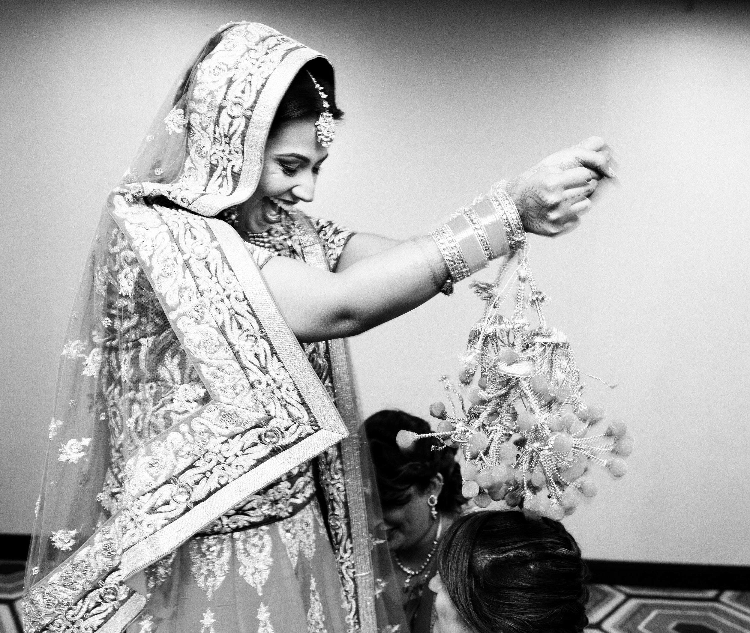 Hand embroidered lehenga looked stunning on bride along with her chooda & kalire.