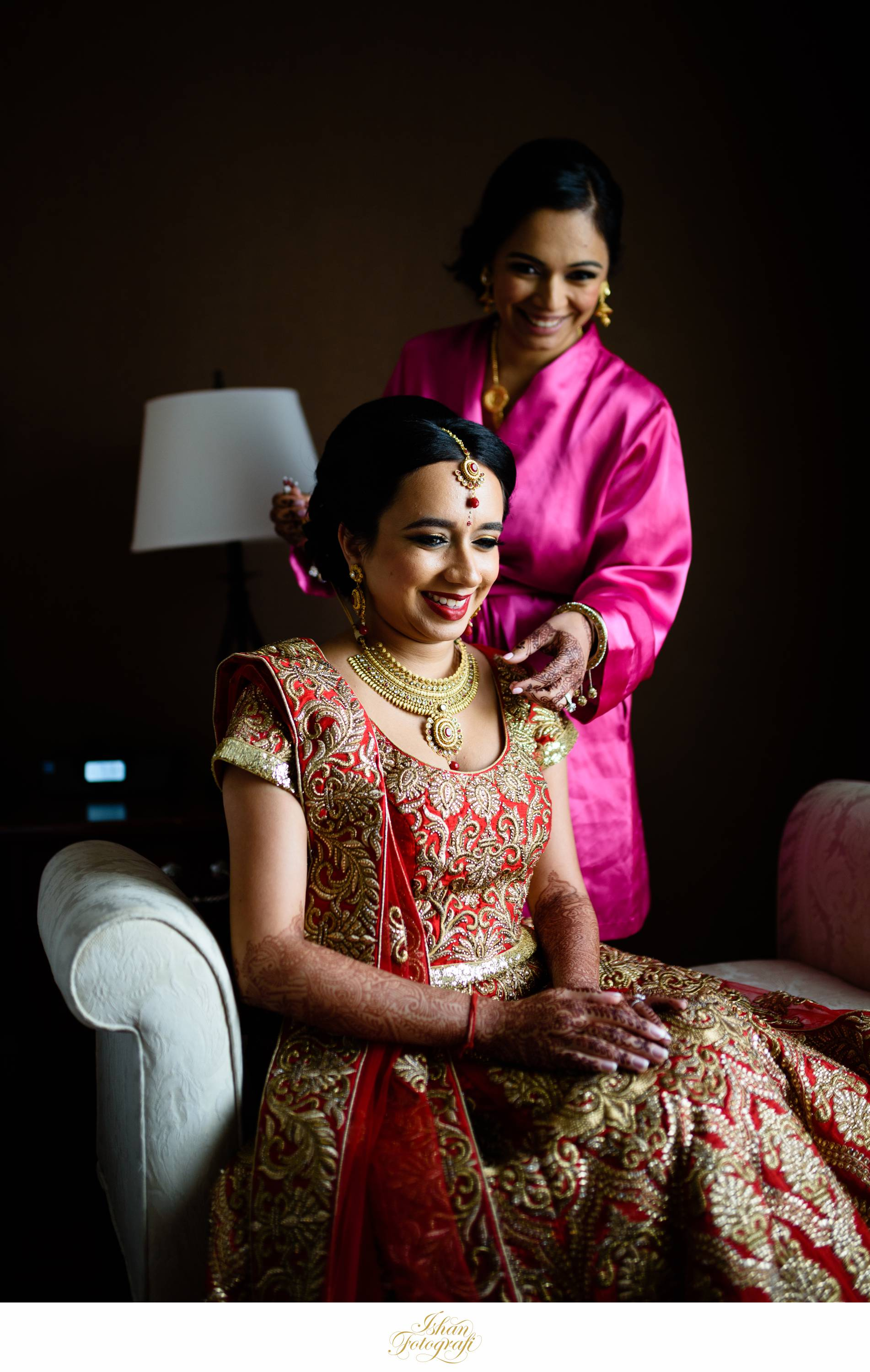 The bride's sister was helping her get ready for her big day. We love documenting moments like these which are timeless memories for our clients.