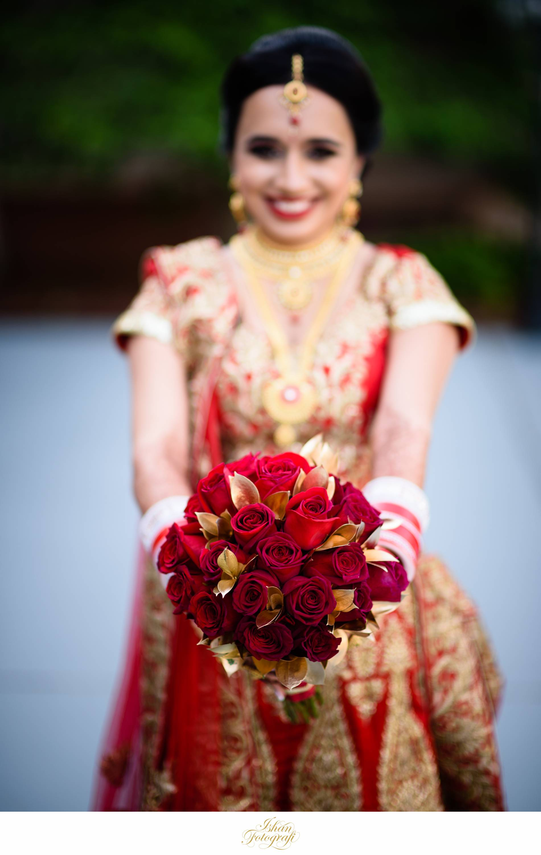 Pooja's bridal bouquet complimented her luxurious lengha so elegantly.