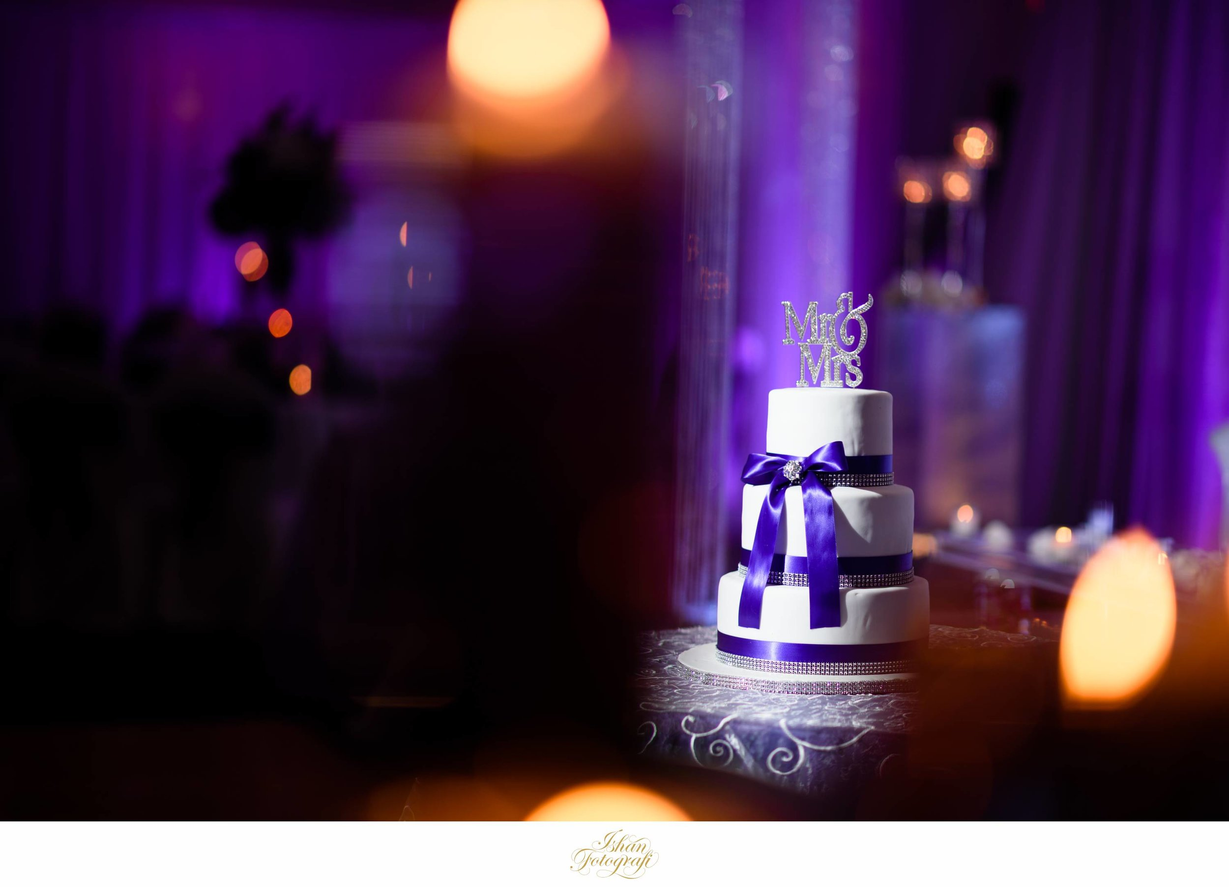 The wedding cake was subtle and matched the brides primary dress color for the evening look.