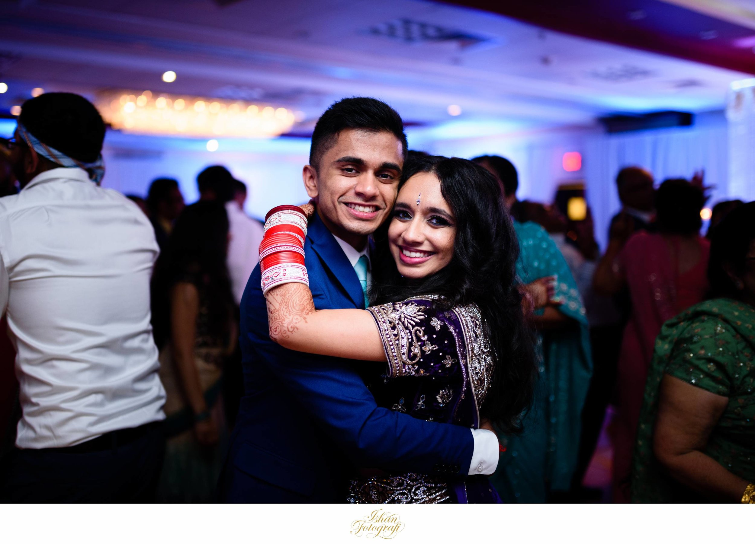 Bride and brother dancing at an indian wedding reception at the Park Savoy in Florham Park, New Jersey.