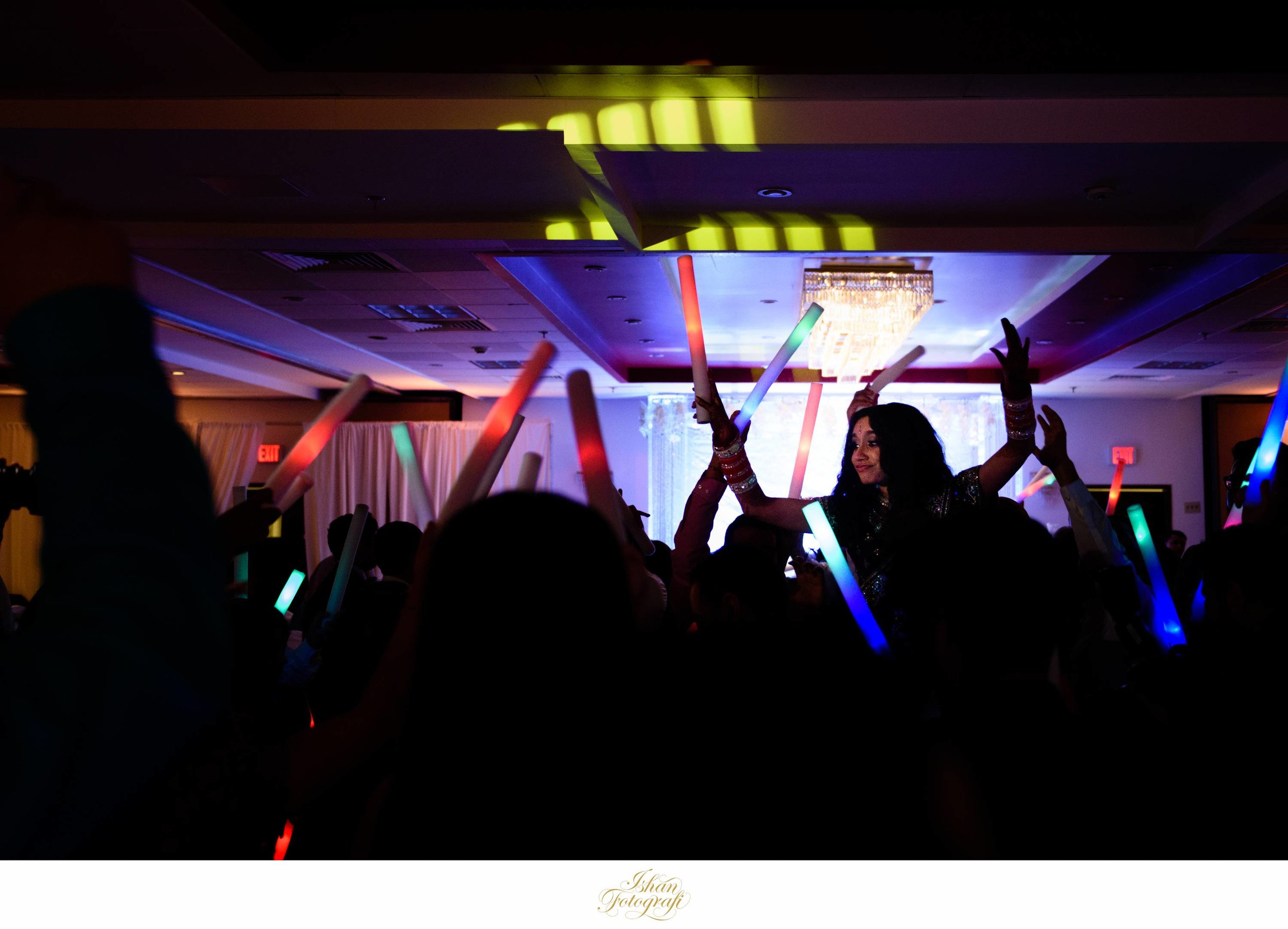 Bringing different props like glow sticks adds a lot of fun and excitement to the wedding reception.