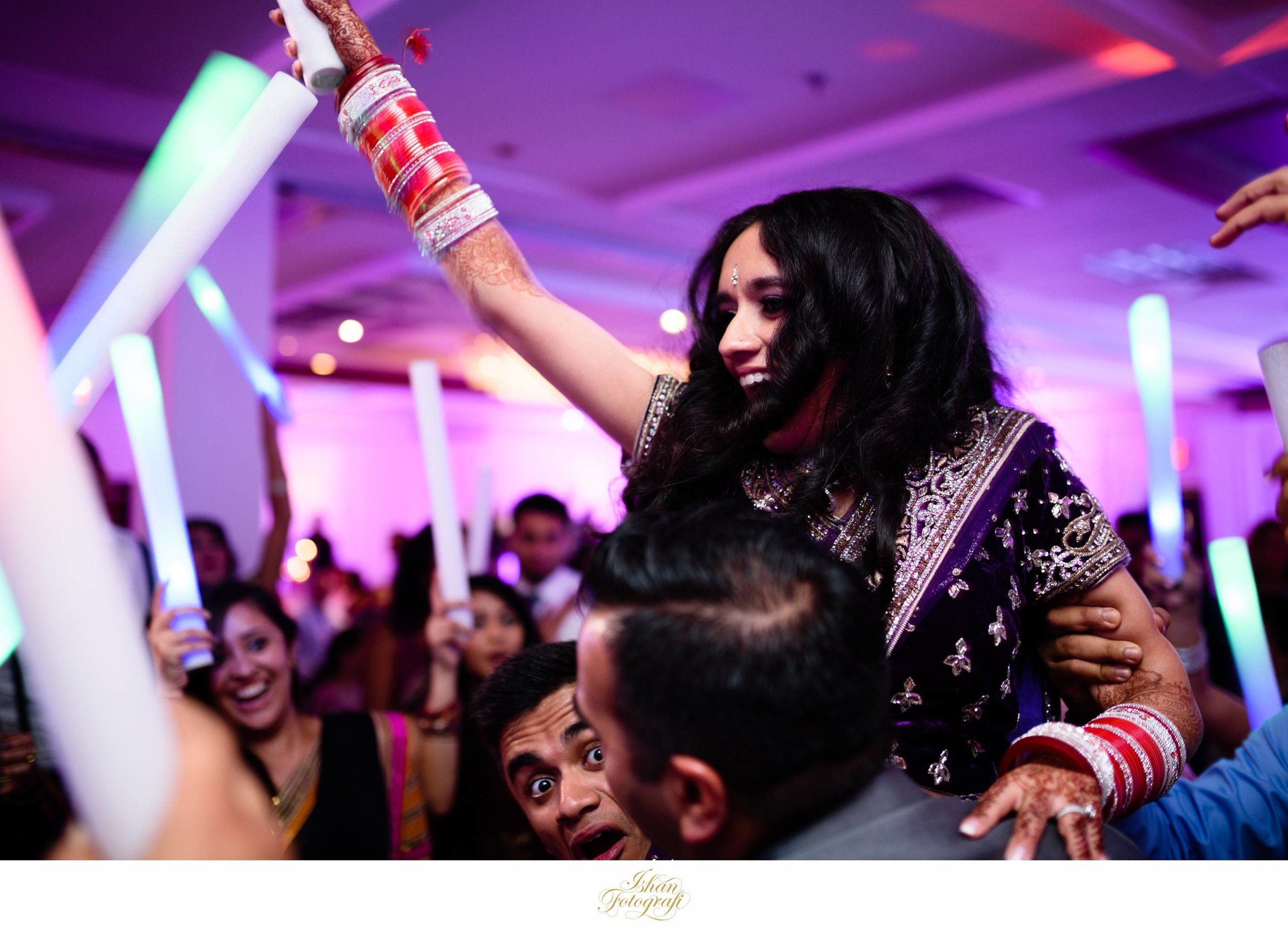 The Bride during a wedding reception being lifted by her brothers. This is very similar to the Hora in Jewish weddings.