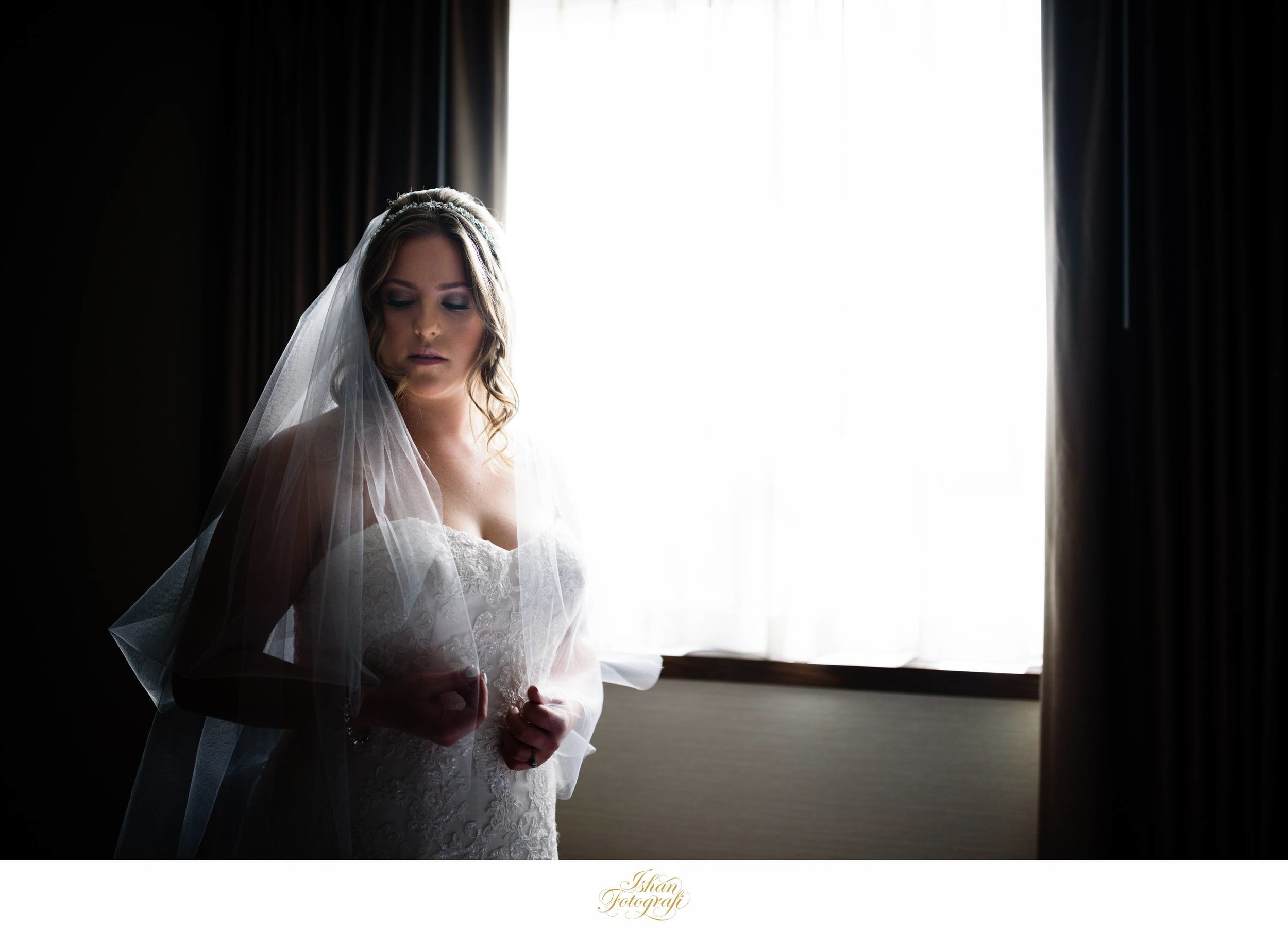 Using the same light and slightly changing our perspective allowed use to create this very moody image of our stunning bride.
