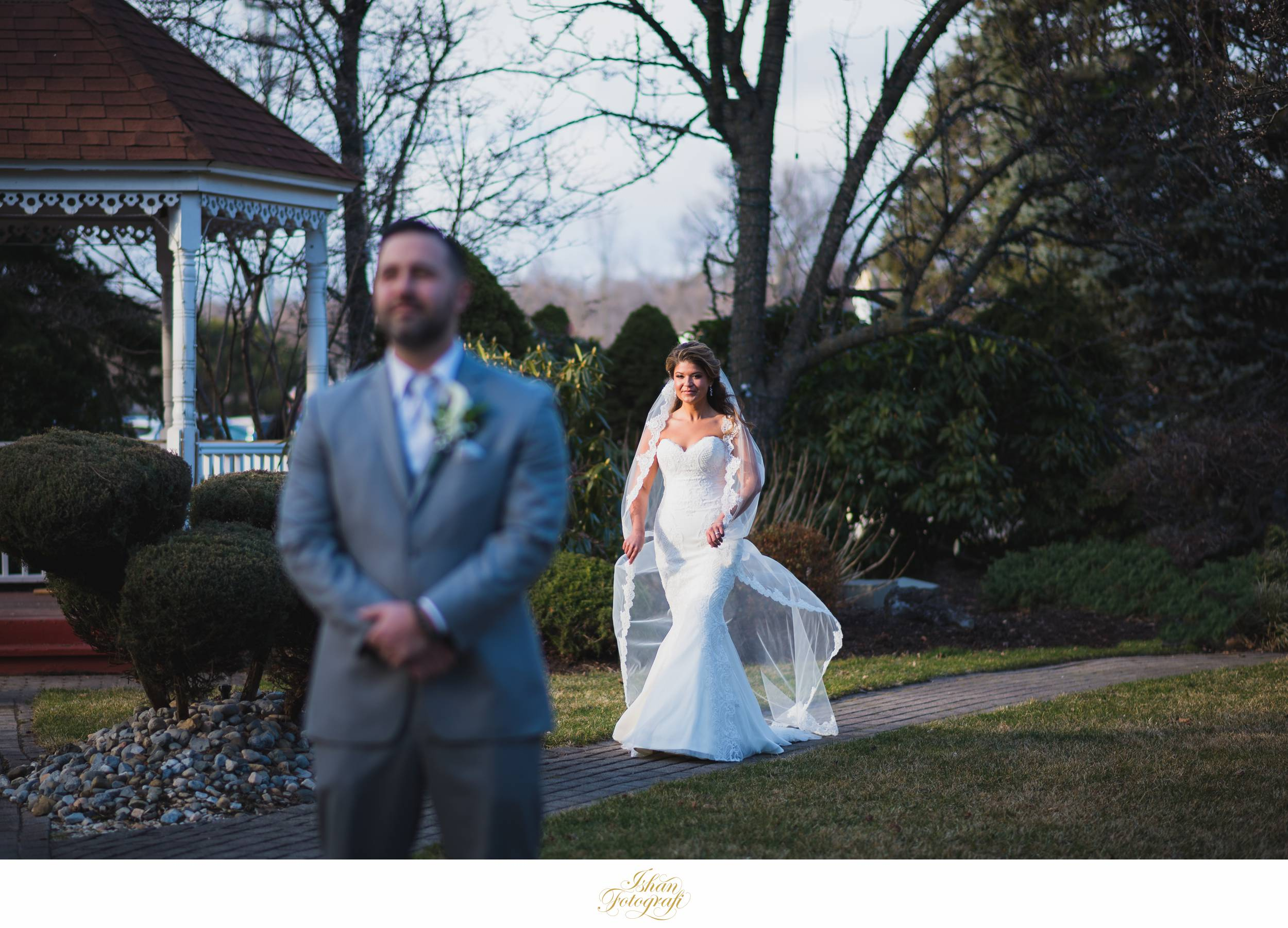 After our bride was ready, it was time for the first look! While she was walking towards the groom we caught her in this gorgeous winter light streaking through the bare trees. Winter weddings in New Jersey can be sometimes challenging but we love the low sun in the sky; it creates such soft light late in the afternoon. As a NJ wedding photographer we love finding and taking advantage of quality light!