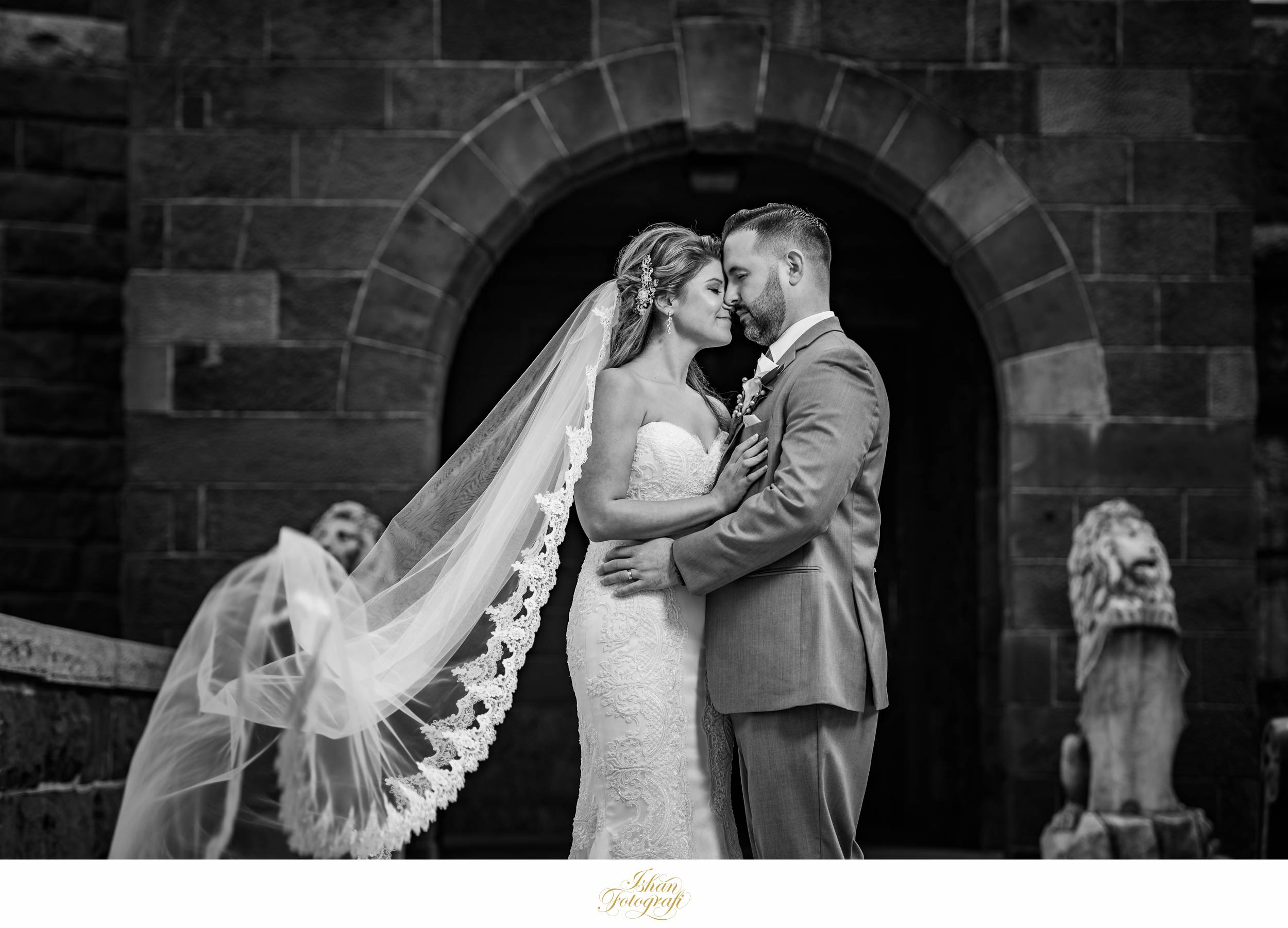 Our bride looked stunning in her gown from  Bridal Reflections . The long veil complimented her gown and she was able to carry her dress flawlessly.